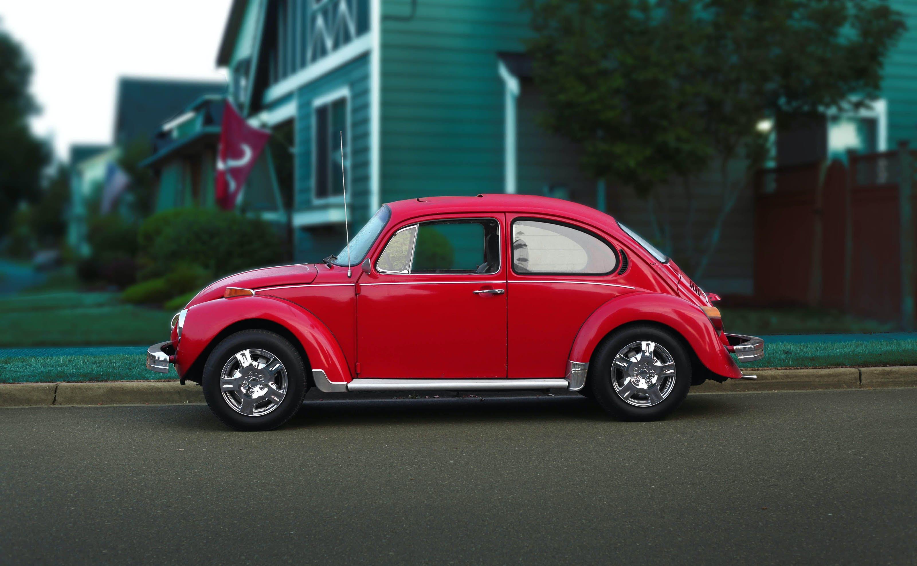 Red Volkswagen Beetle On Road