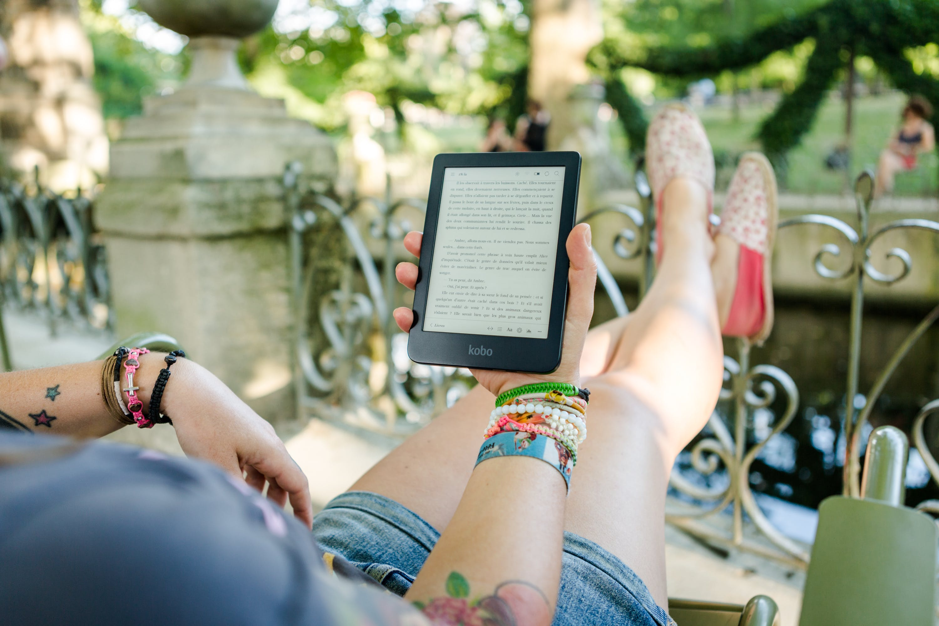 Person Holding   Person Holding Kobo E-reader