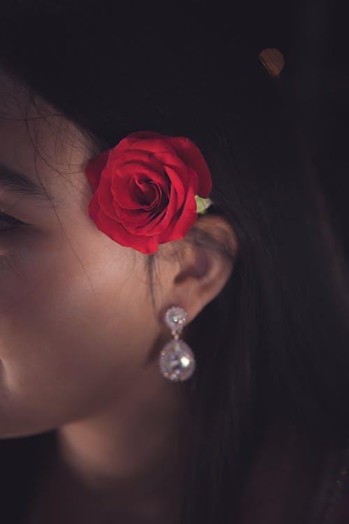 Red Rose on Women's Ear