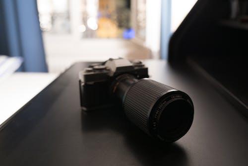 Darmowe zdjęcie z galerii z aparat, biurko, fotograf, fotografia