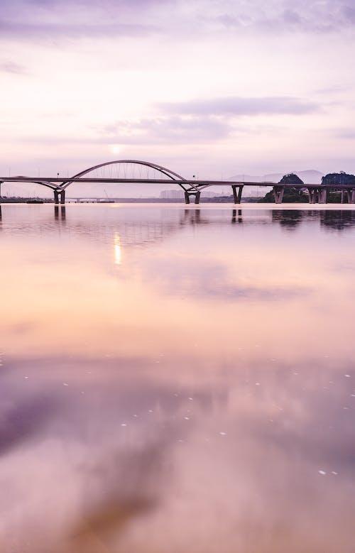 Gratis arkivbilde med bro, soloppgang