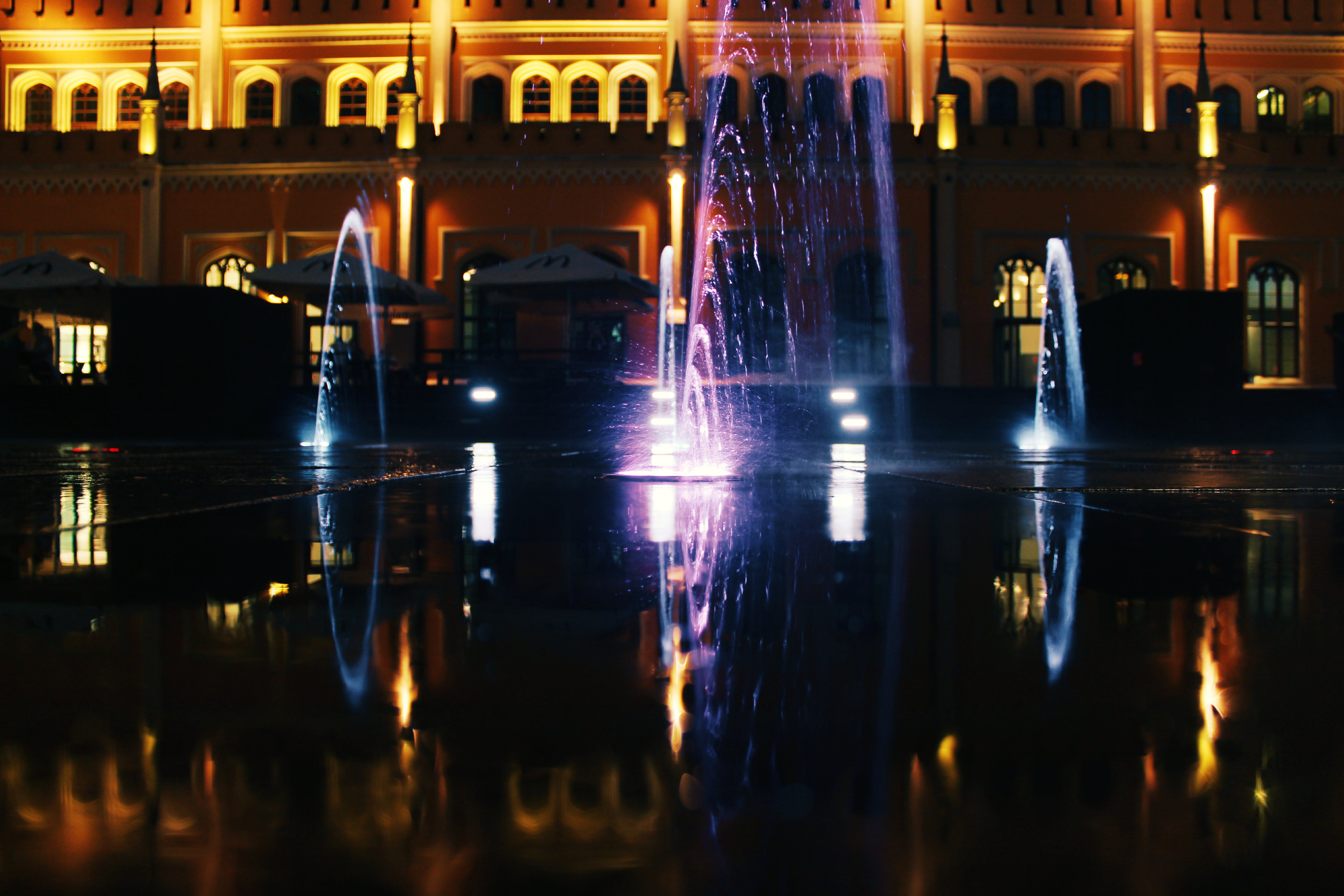 Turned-on Fountains With Light Effect at Nighttime