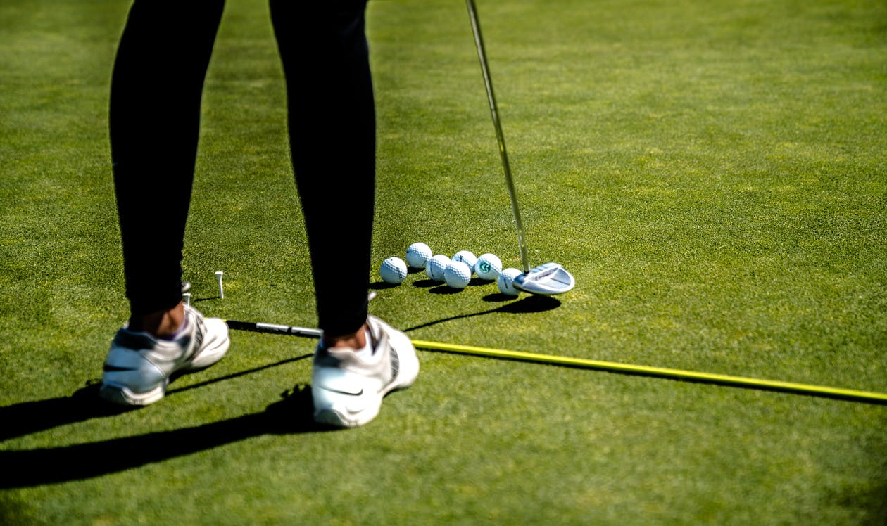 Woman Holding Golf Driver