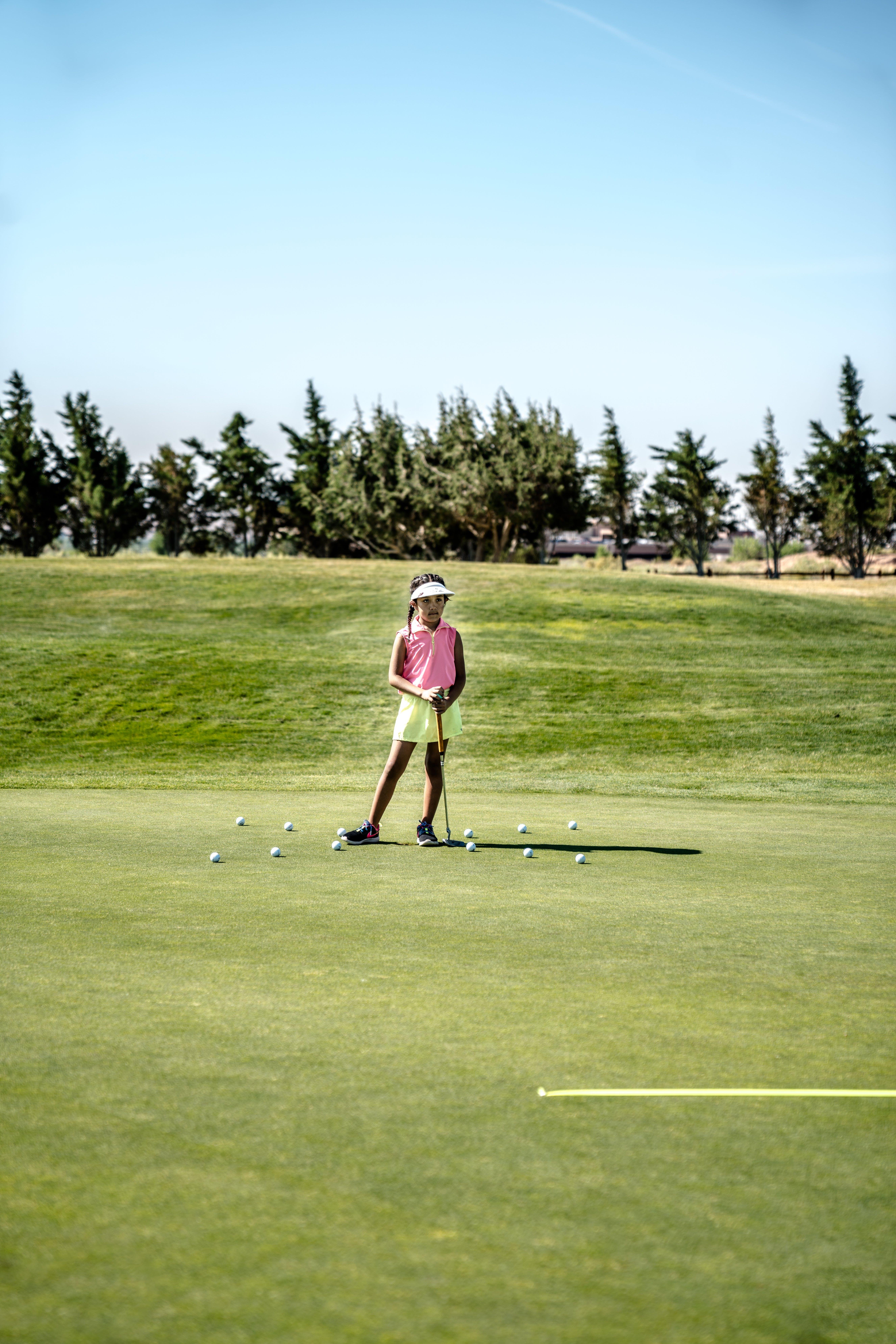 Girl Holding Golf Club