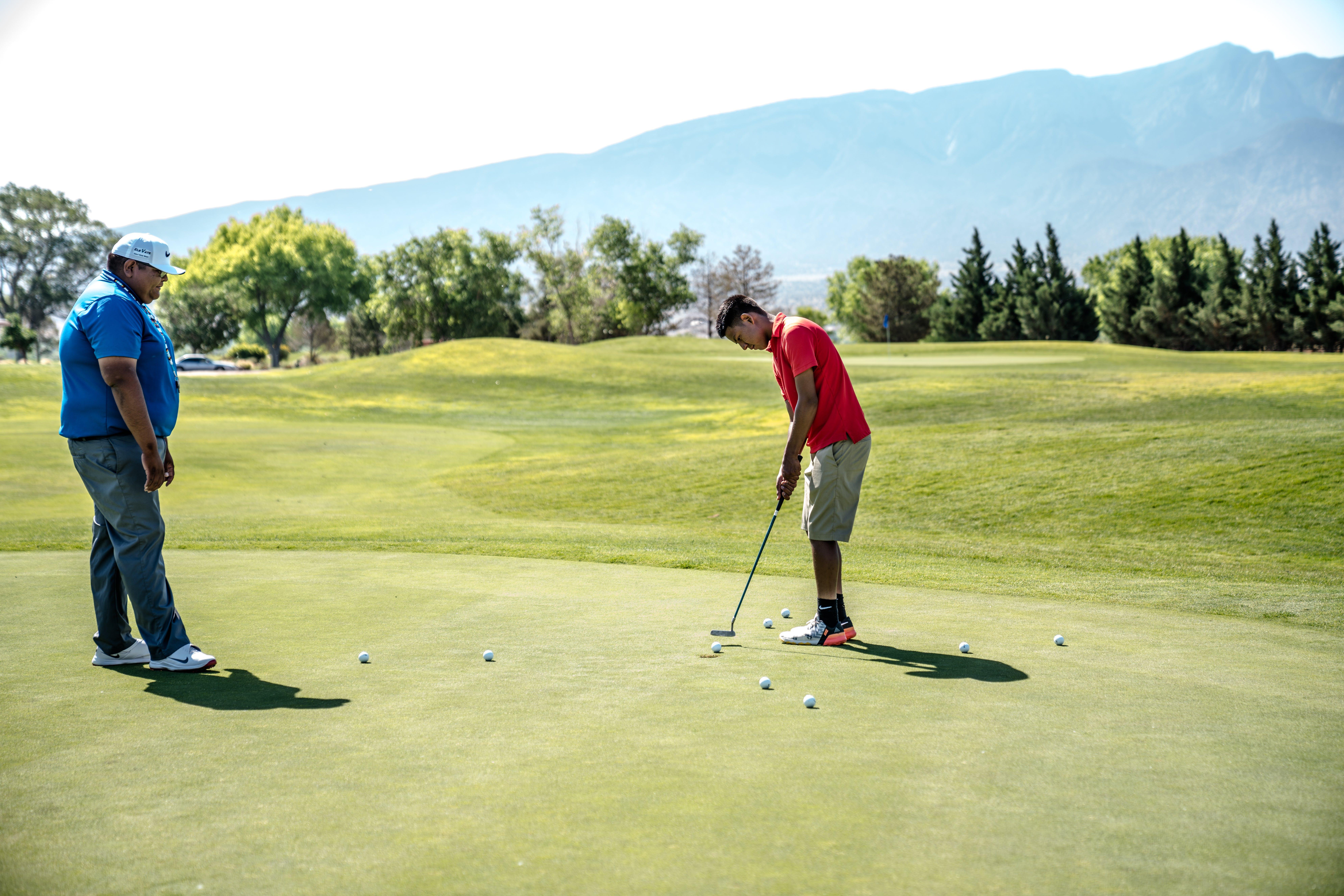 Two Men Playing Golfs
