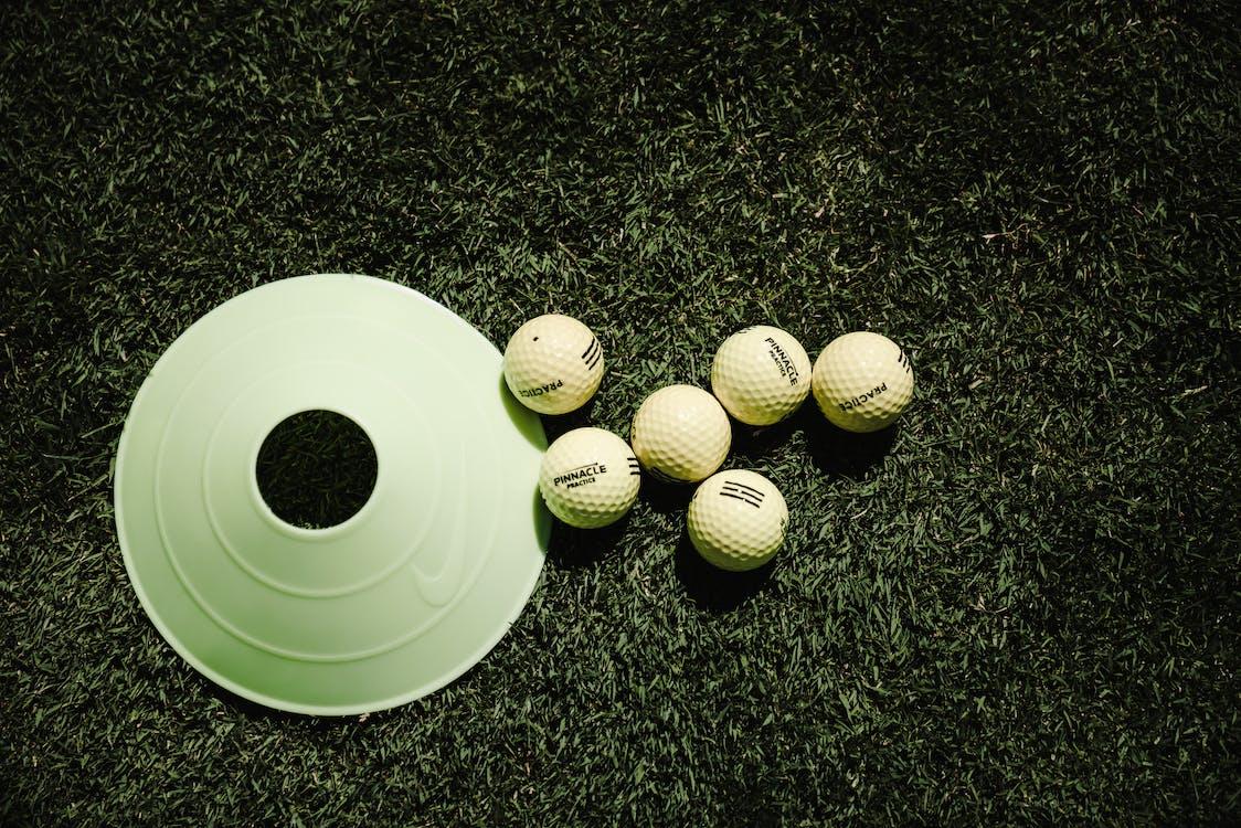 Six Golf Balls Near Golf Disc