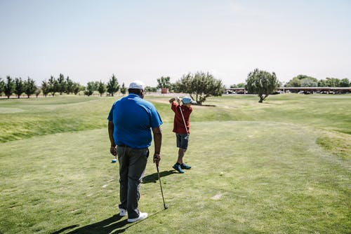Man Wearing Red Shirt Playing Golf