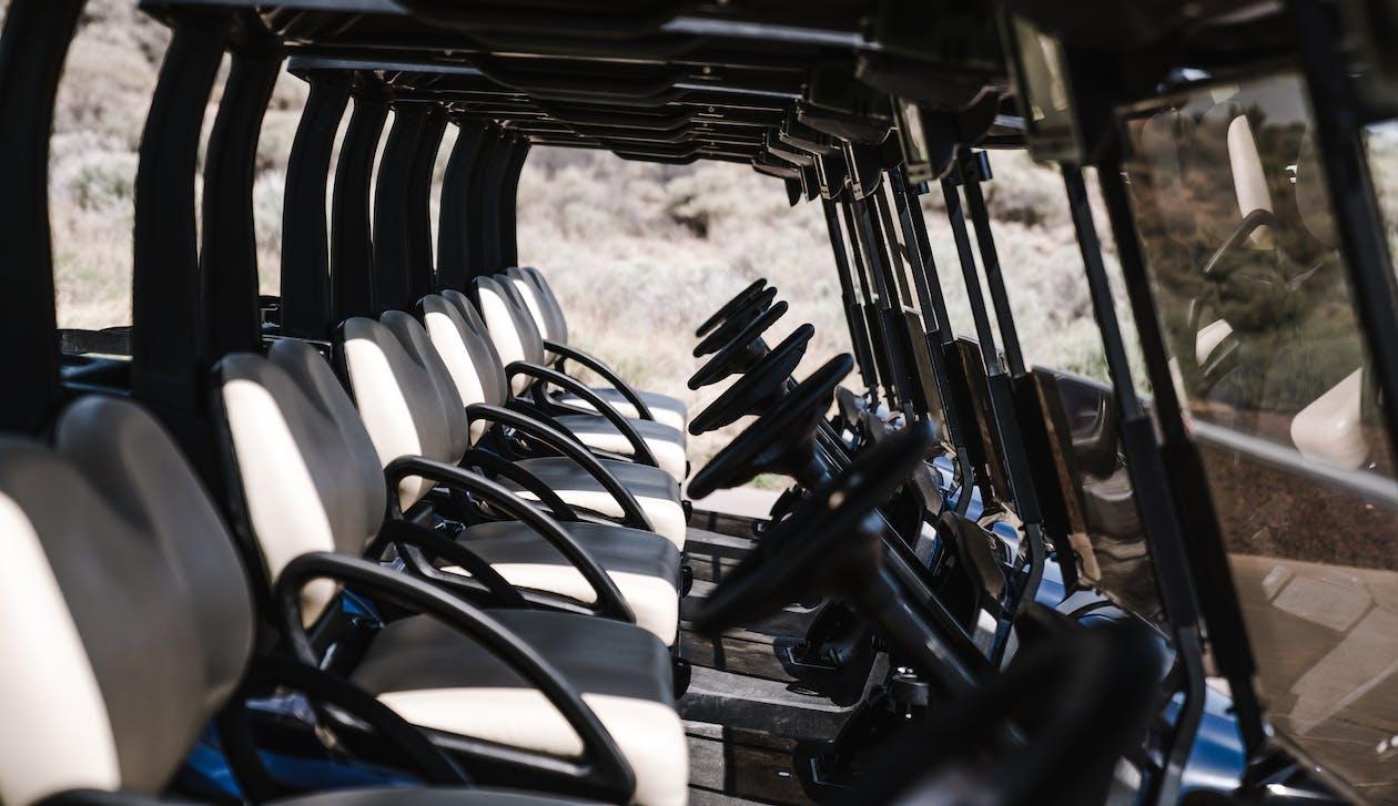 Row of modern ATV near hillside in daylight