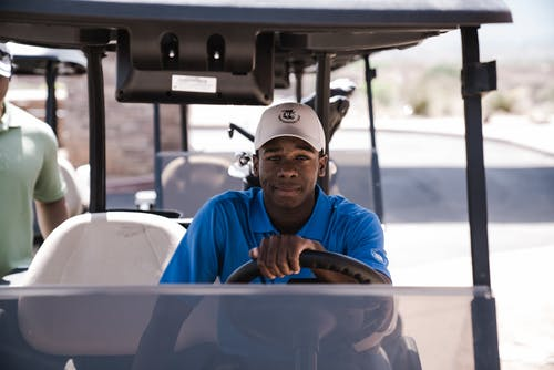 Man Sitting on Golf Cart