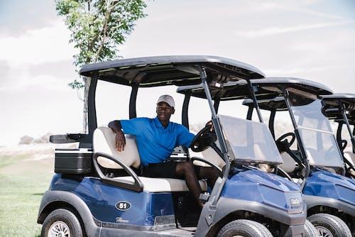 Man Riding on Golf Cart