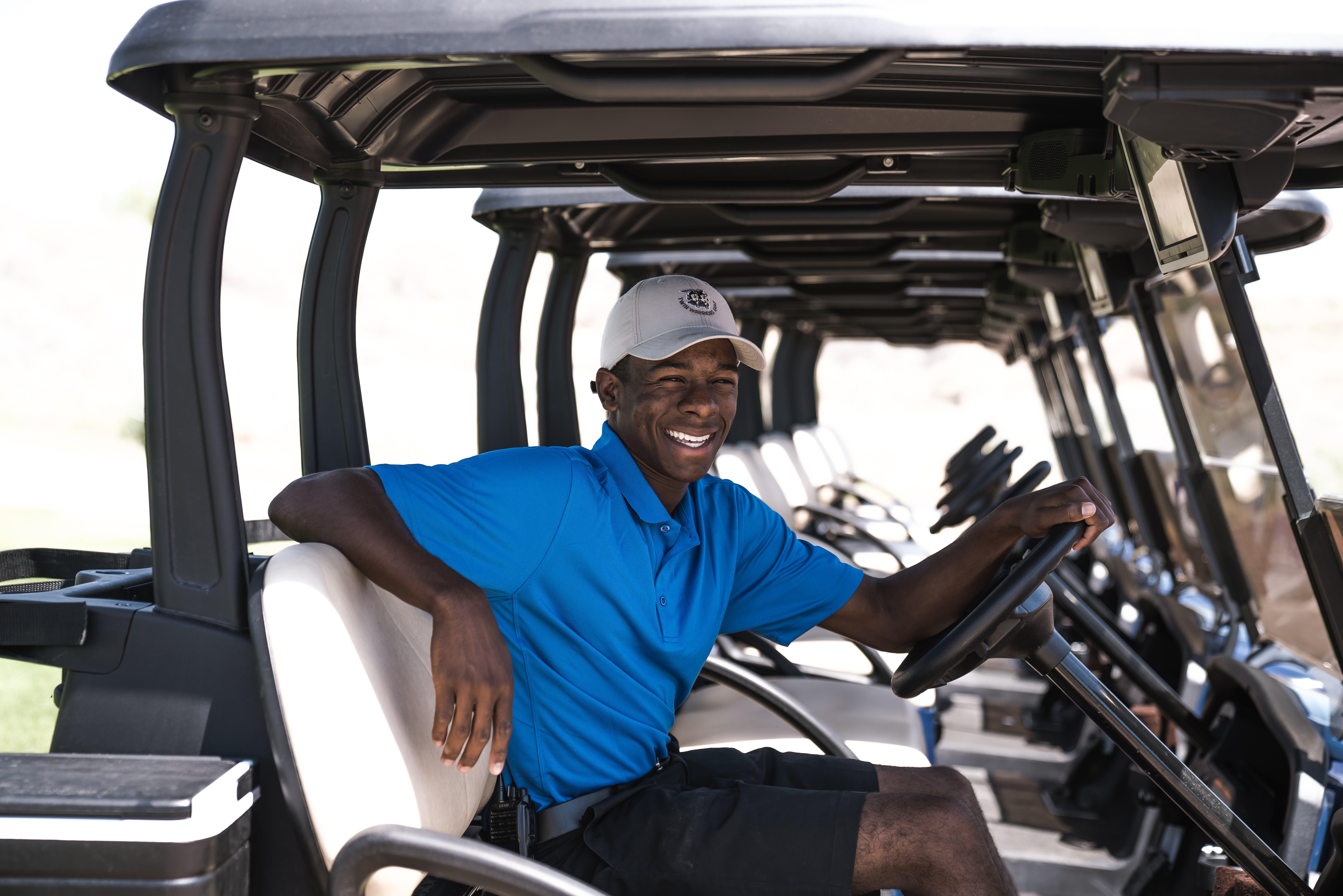 Man Sitting on Black and Gray Golf Cart