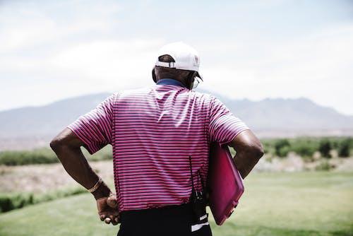 Man Holding Pink Case