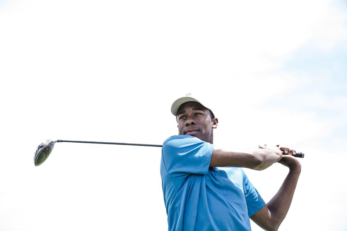 Man Wearing Blue Shirt Playing Golf