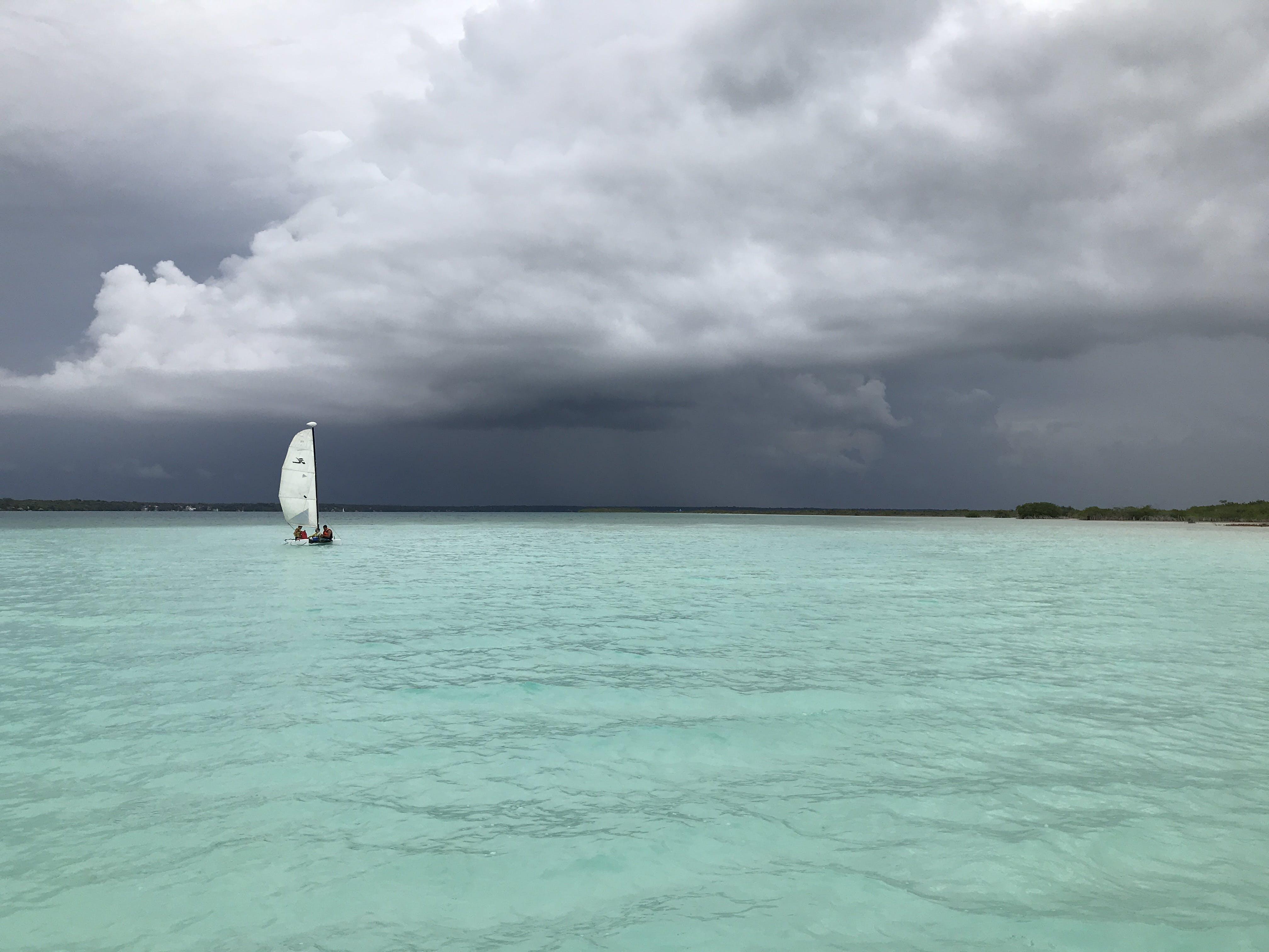 Free stock photo of aquamarine, boat, cloudy, lagoon