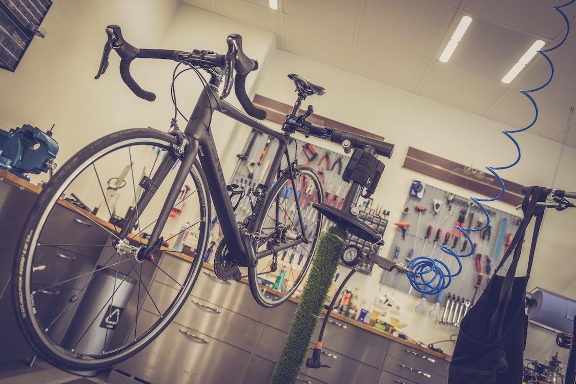 Black Road Bicycle having maintenance performed