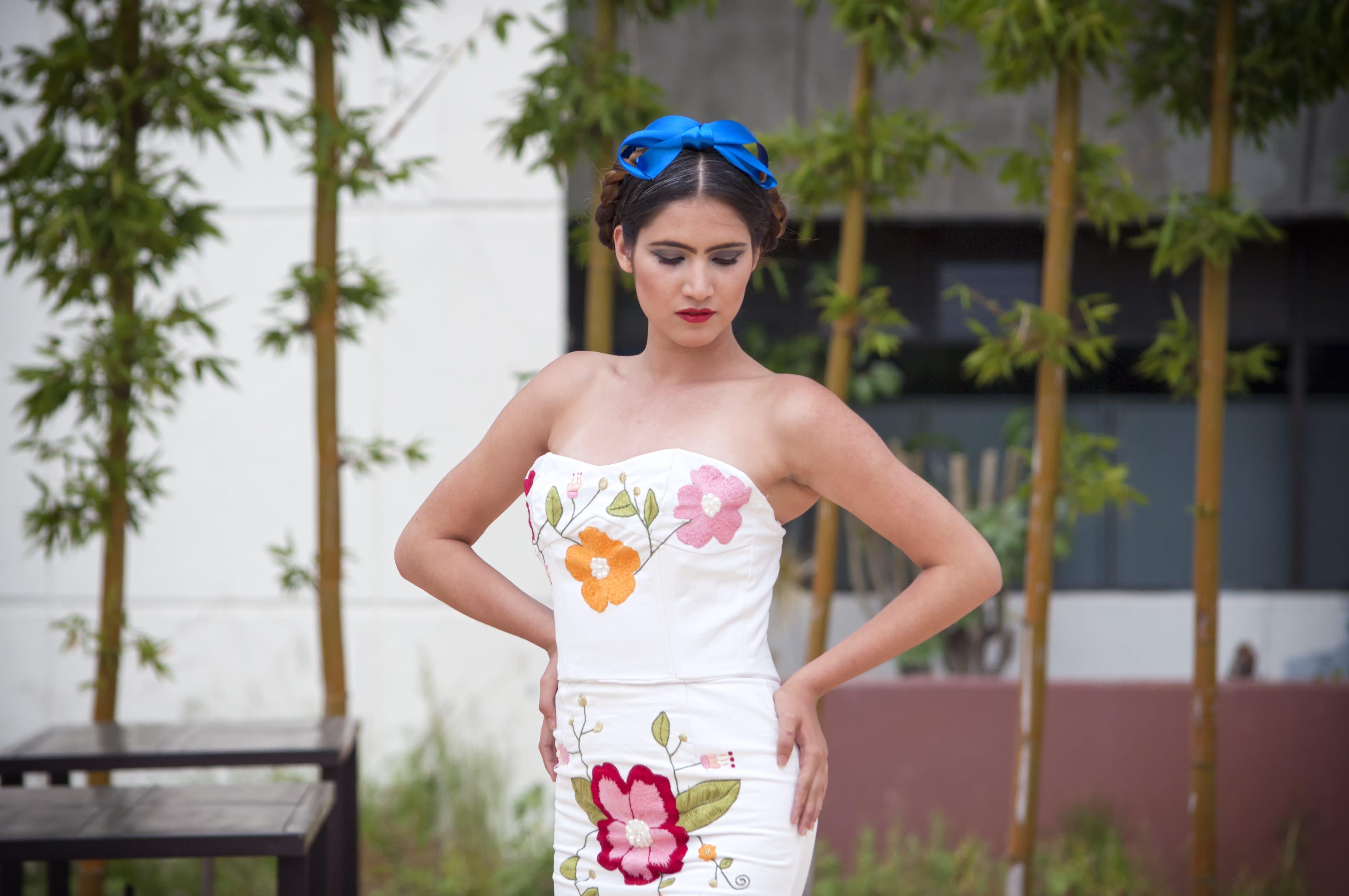 Woman In White Sweetheart Neckline Dress