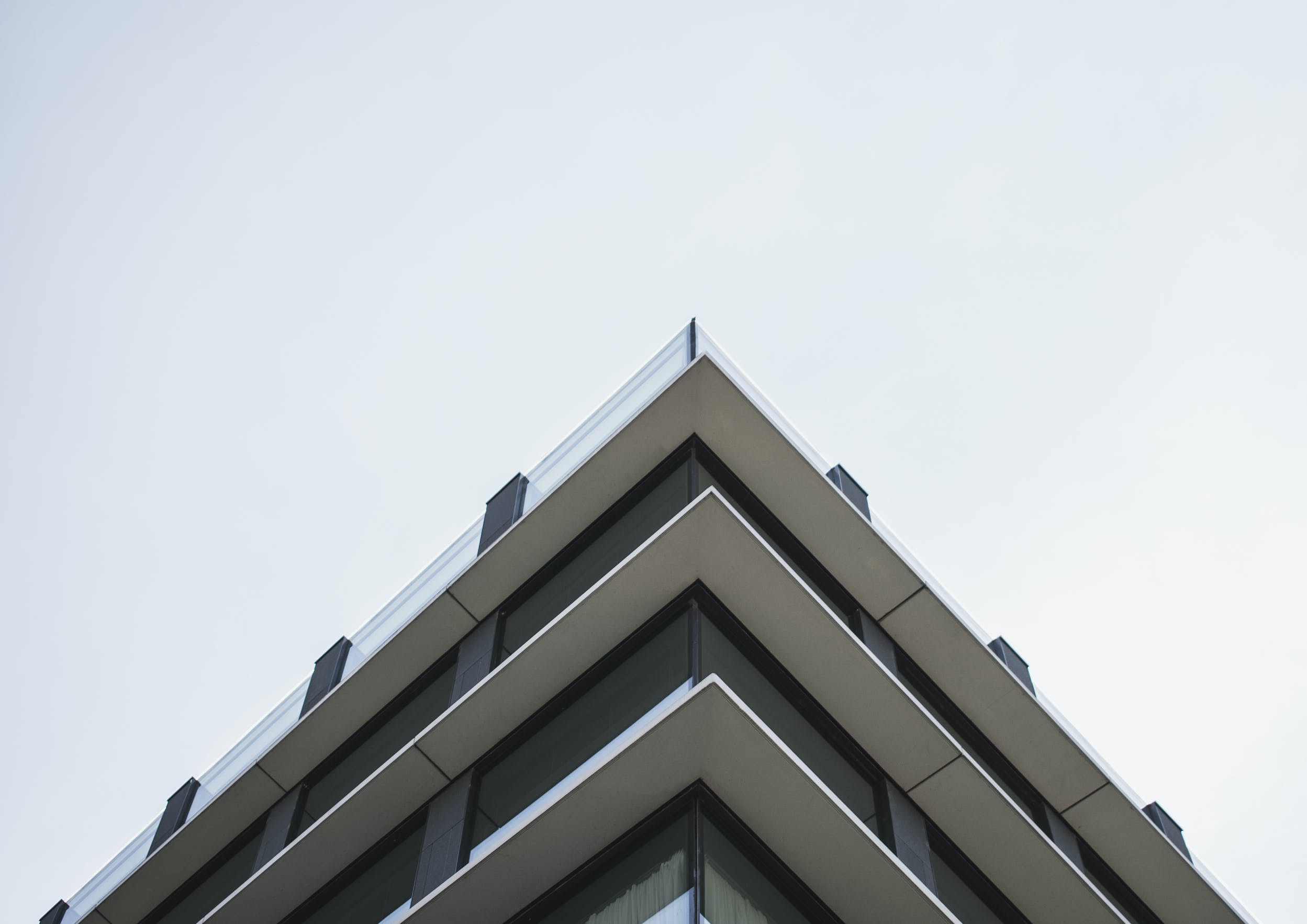 Low Angle Photo of White Concrete Building