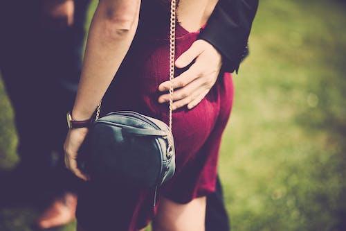 Woman Carrying Sling Bag
