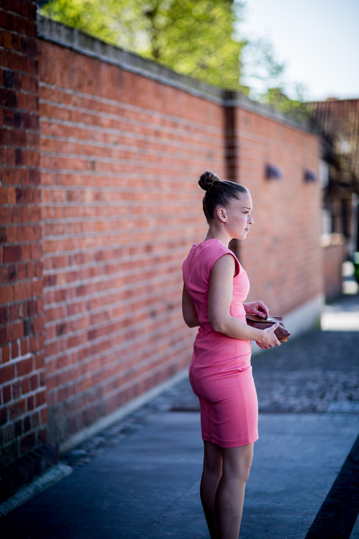 Woman Wearing Pink Sleeveless Dress Standing