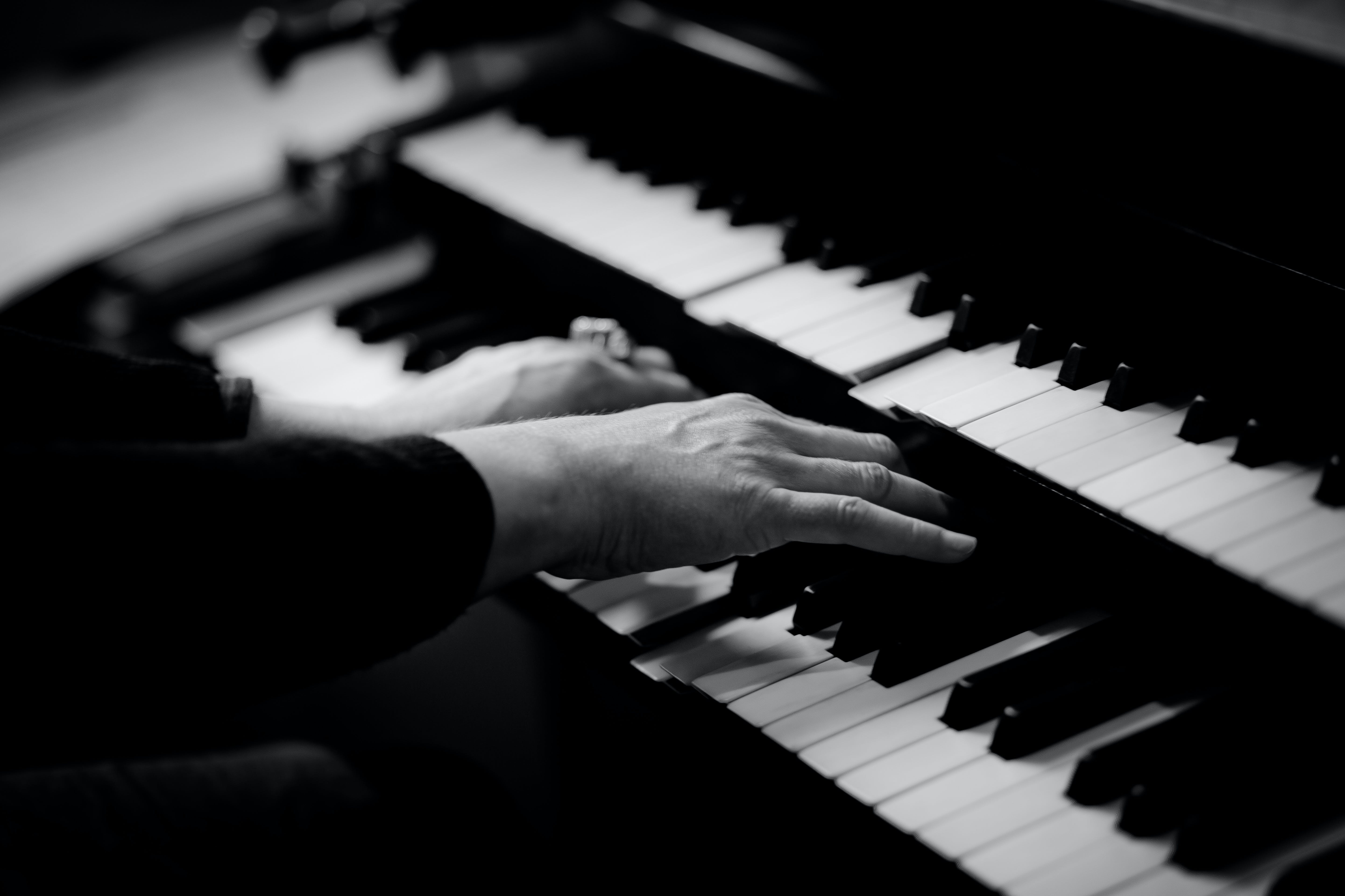 Person Playing Musical Organ Grayscale Photo