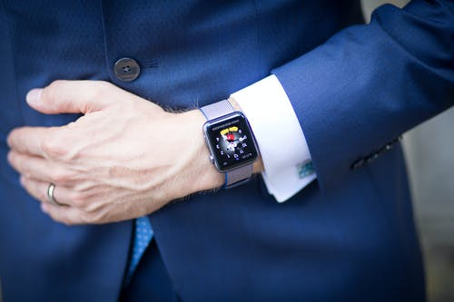 Man Wearing Blue Blazer and Silver Smart Watch