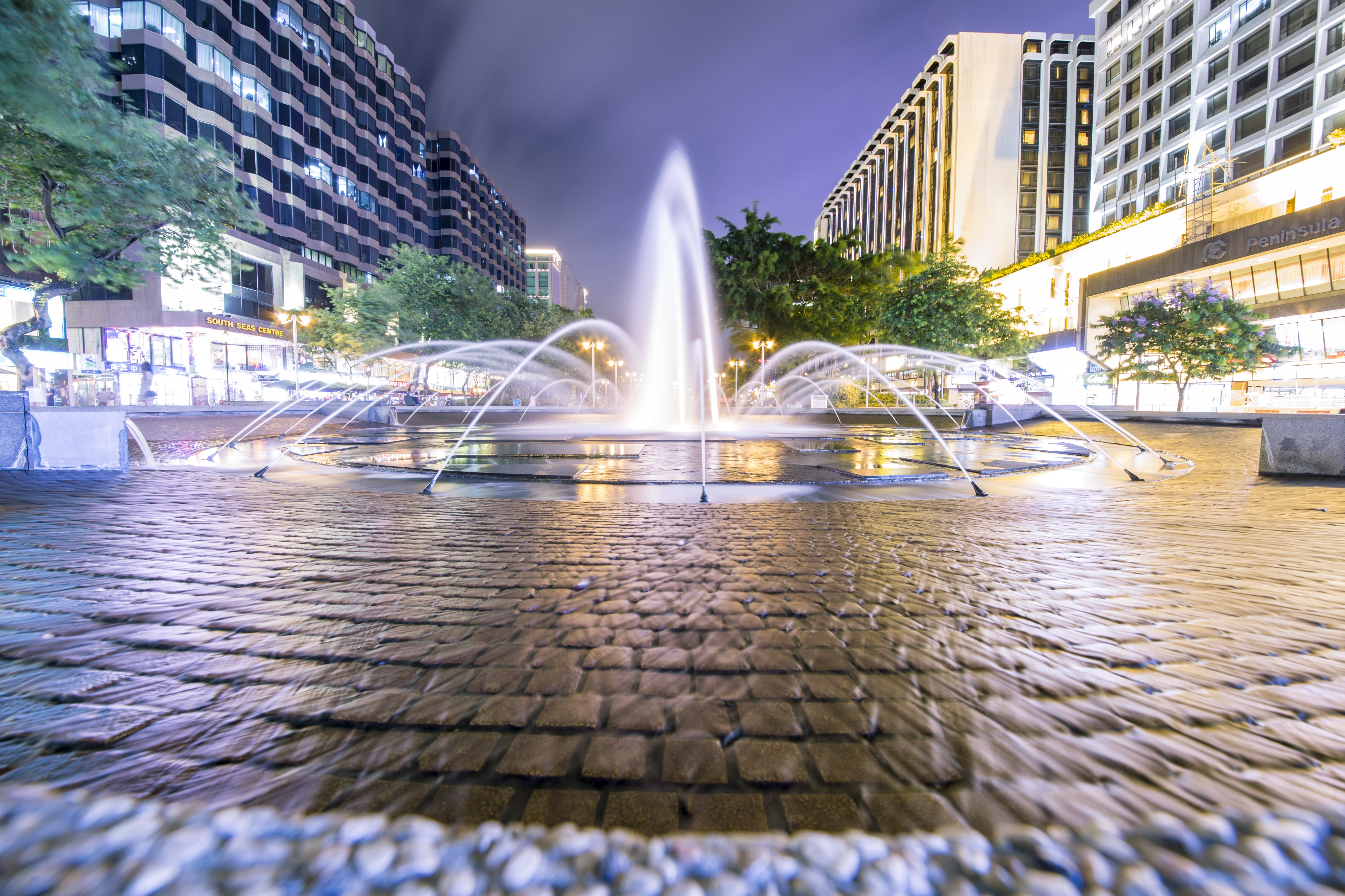 Fountain Surrounded by Trees and Buildings