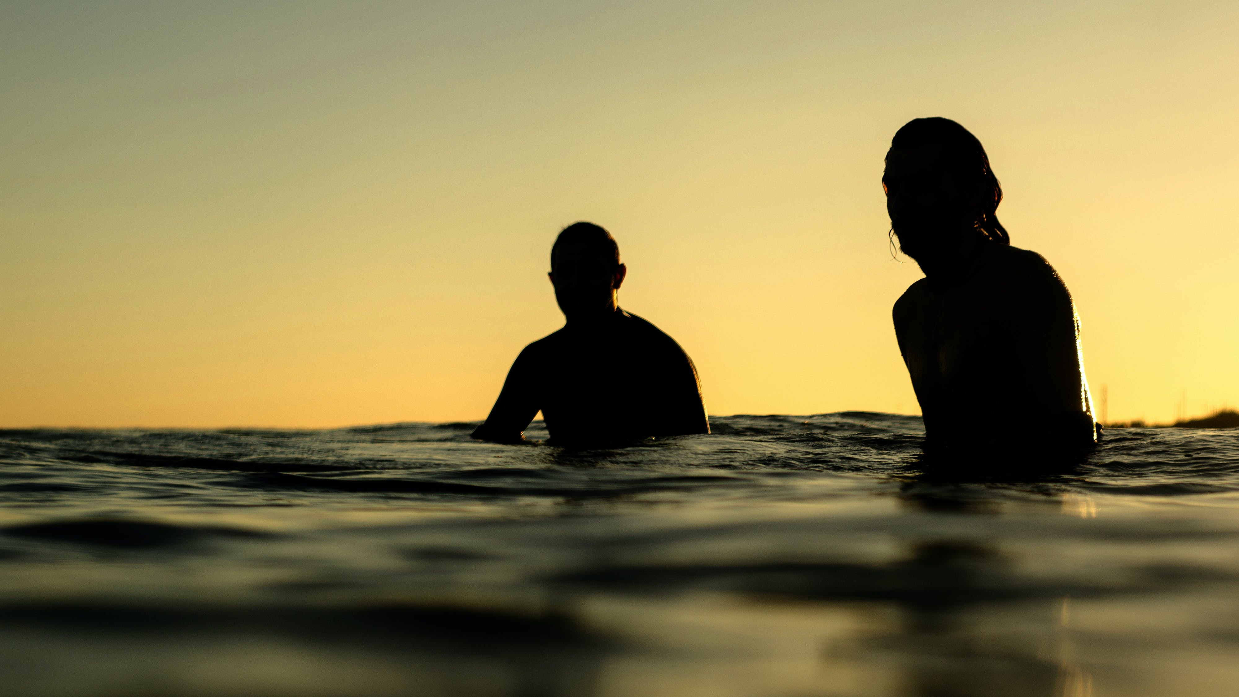 Silhouette of Two Person in Water