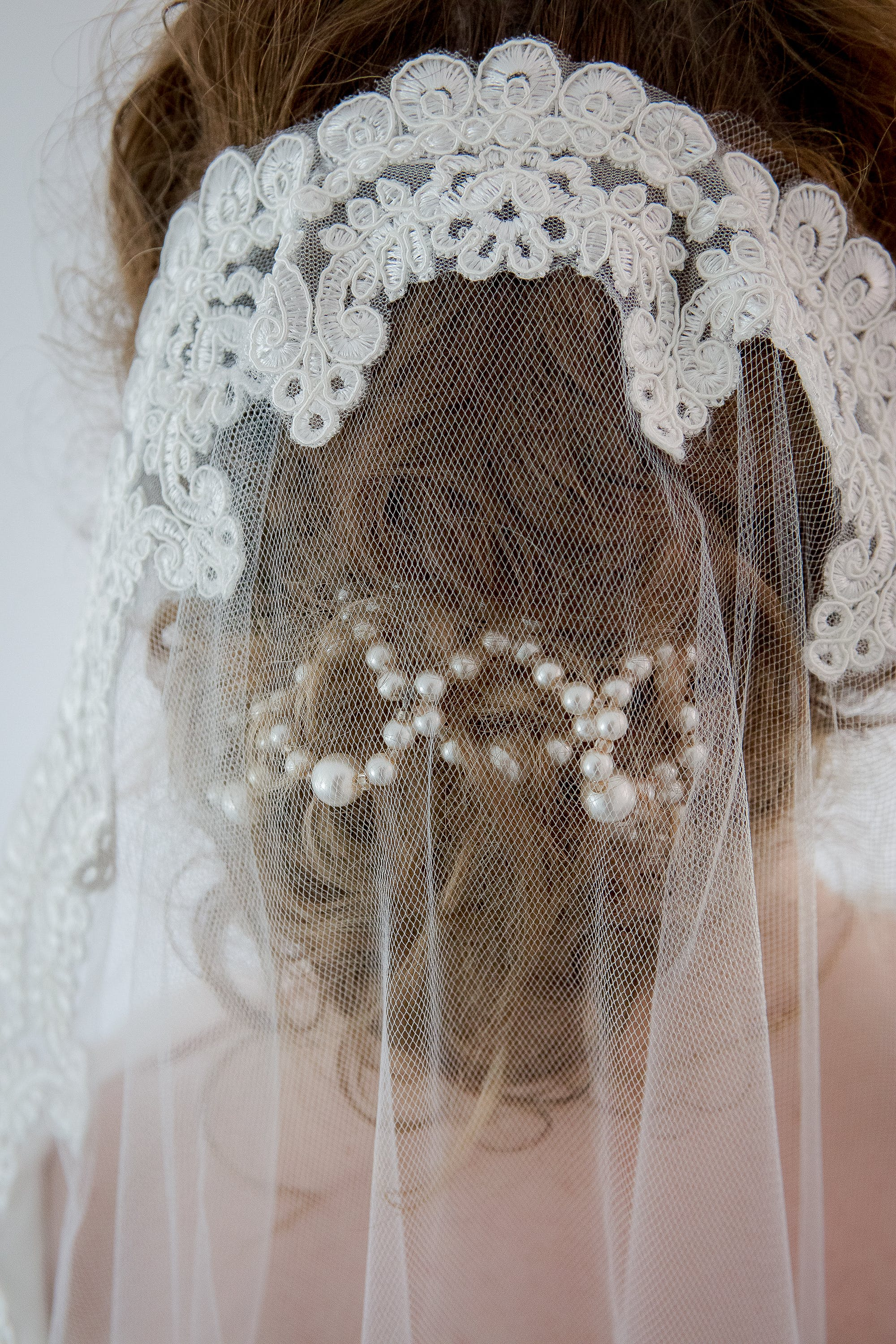 Bride Wearing White Floral Veil