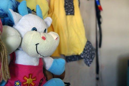 Free stock photo of children toys, cow, stuffed toys