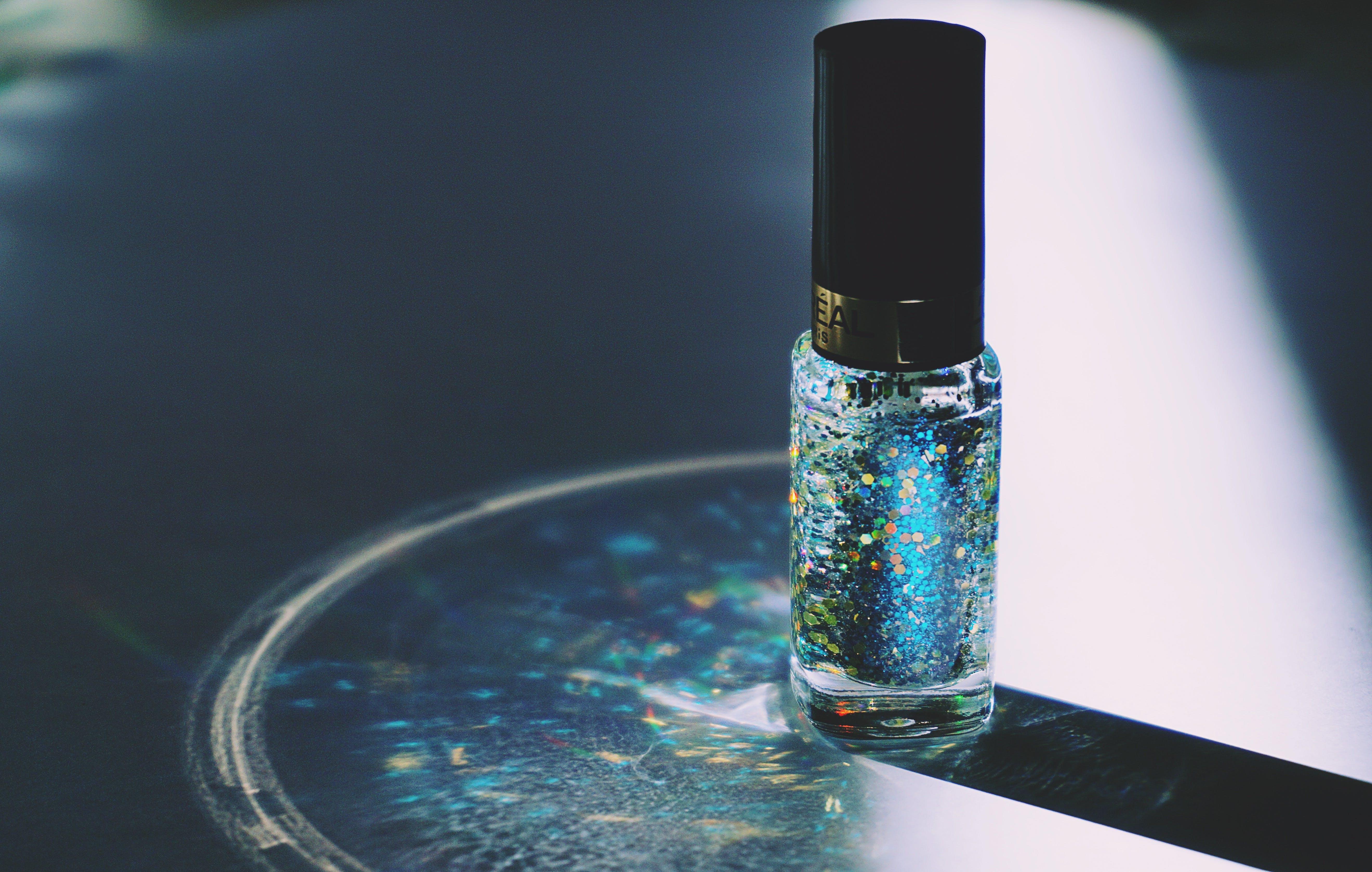 Closed Blue Glitter Nail Polish Bottle