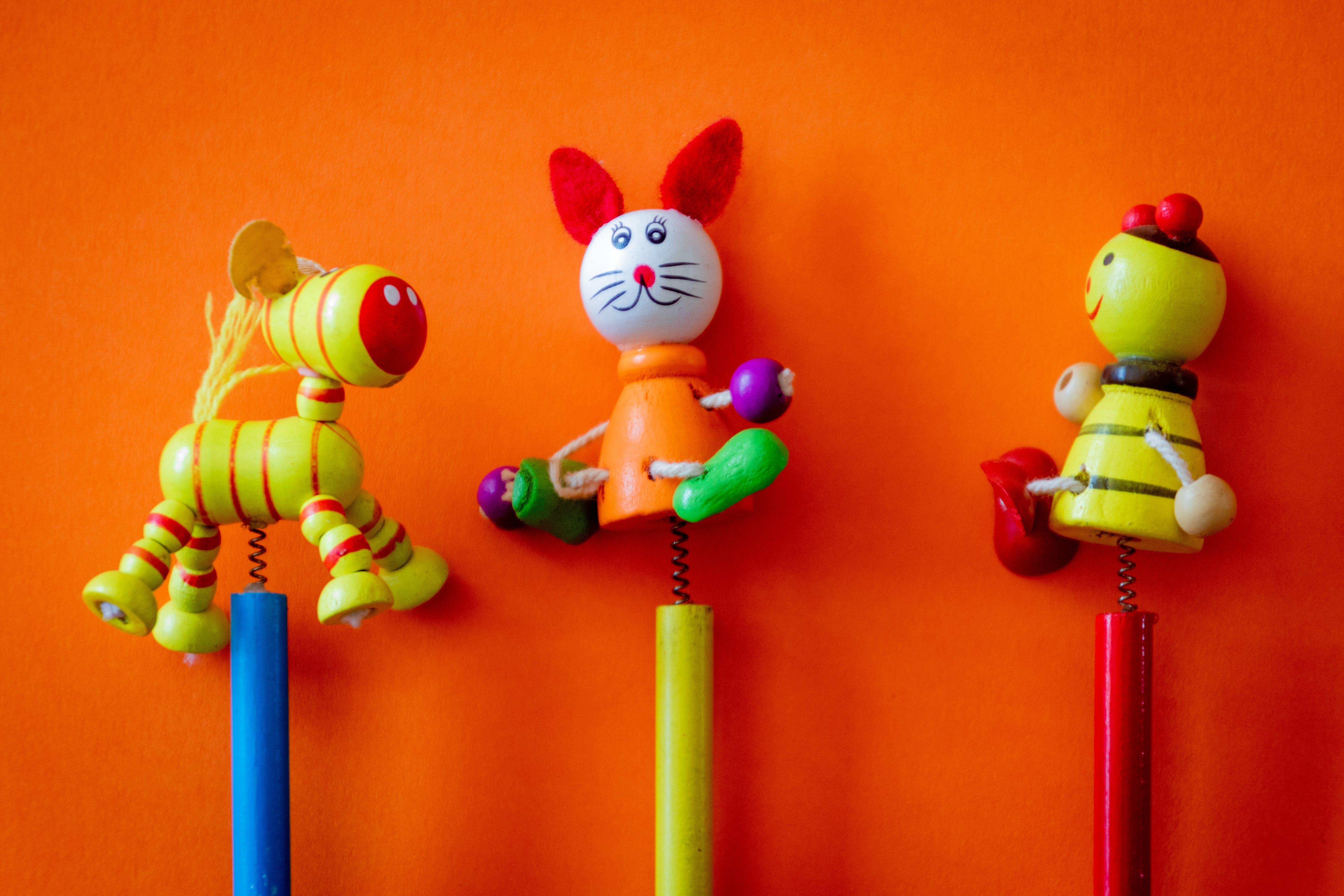 Three Yellow, Orange, and Black Toy Sticks