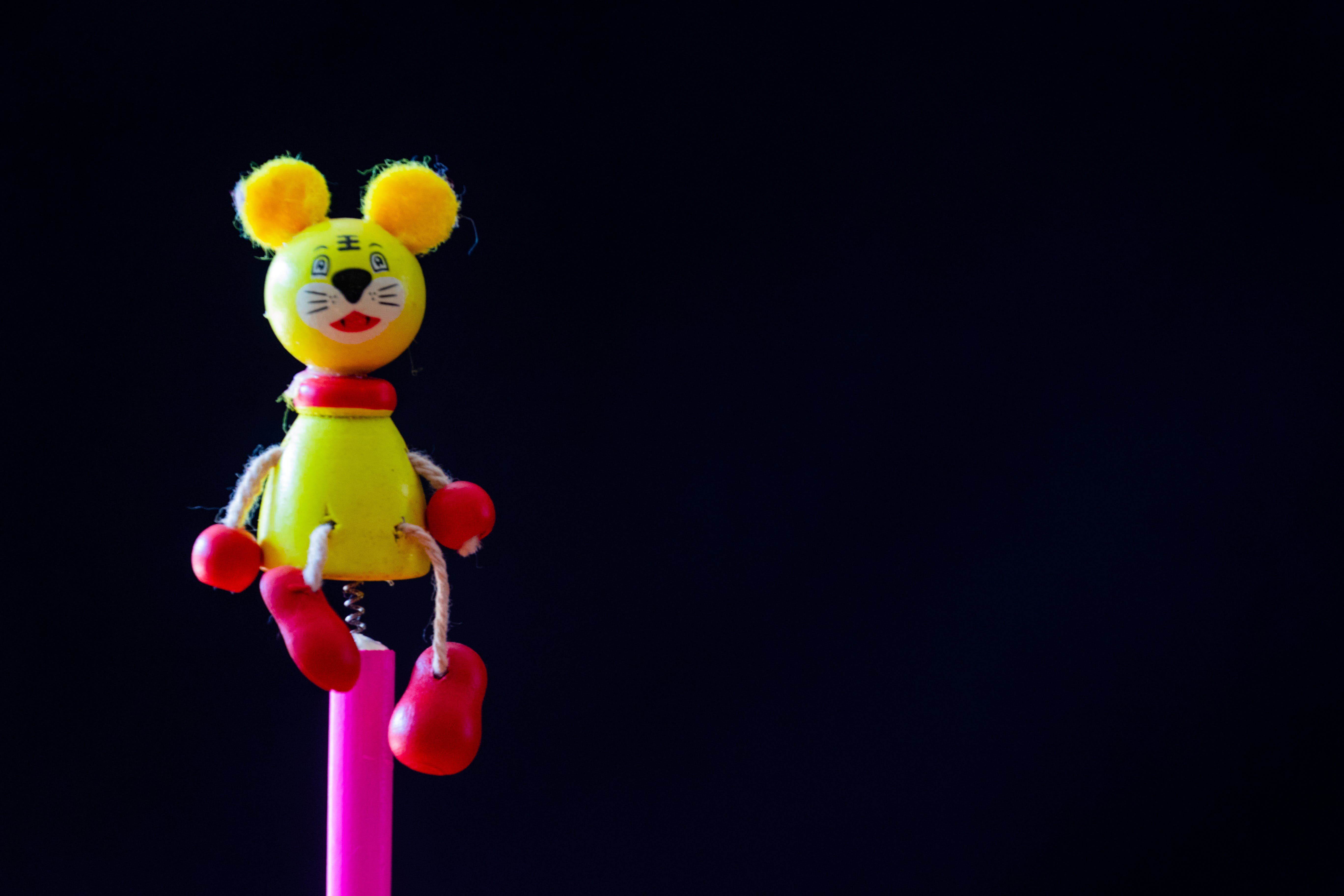 Close-up Photo of Yellow and Red Mouse Character Toy