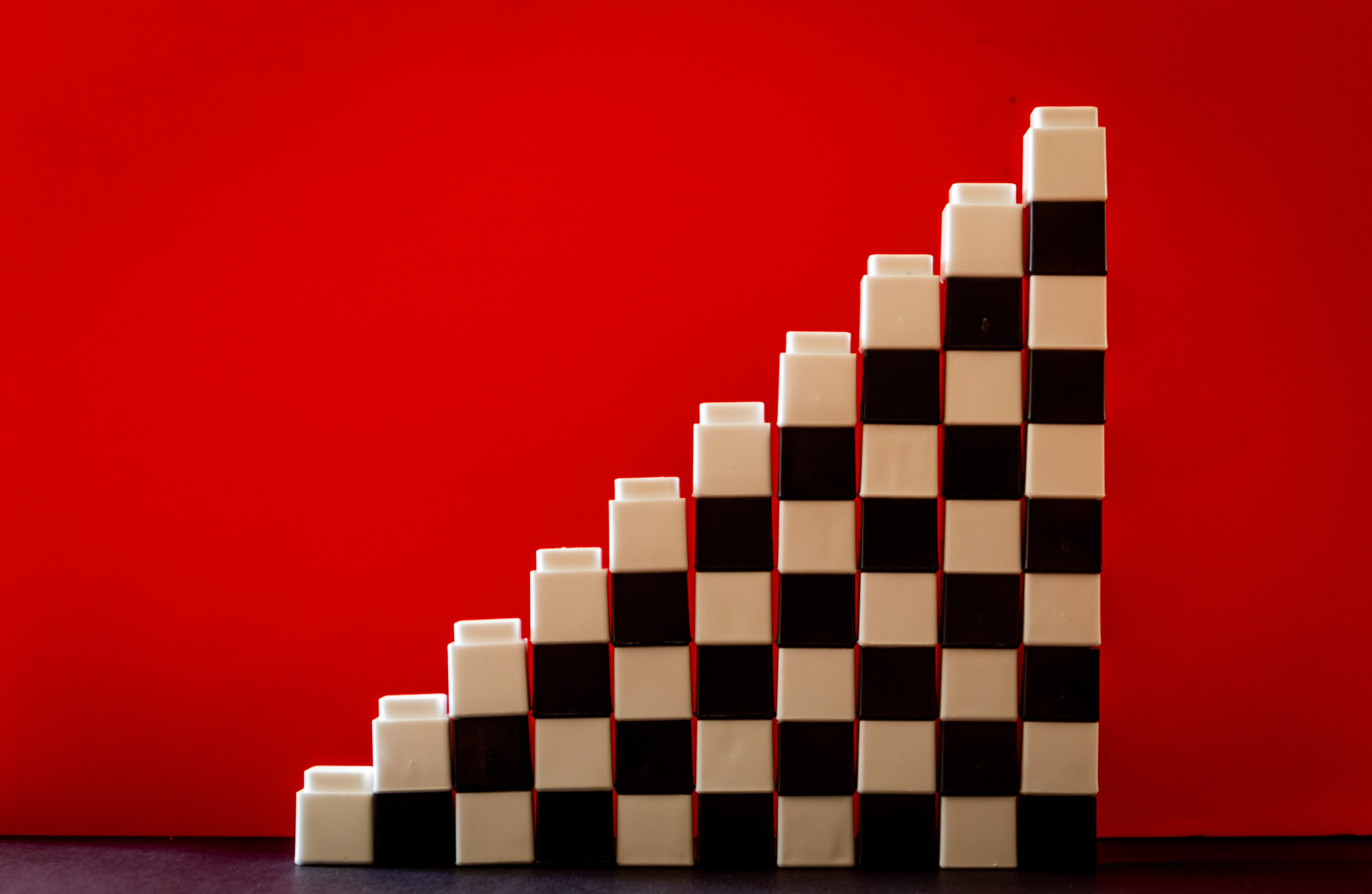 White and Black Checkered Brick Toys Stacked on Top of Each Other Forming Ladder