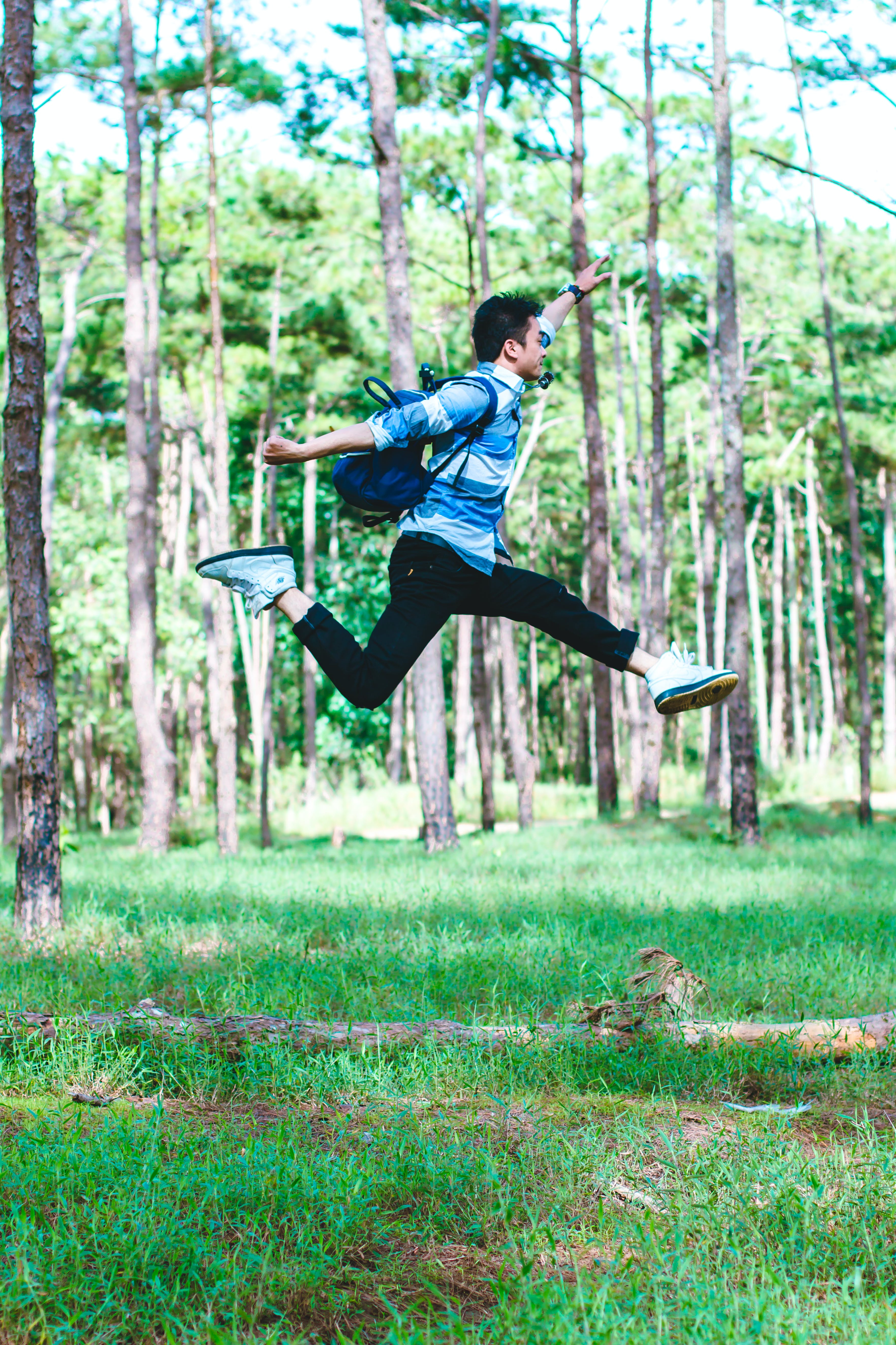 Man Wearing Backpack Jumping Photo