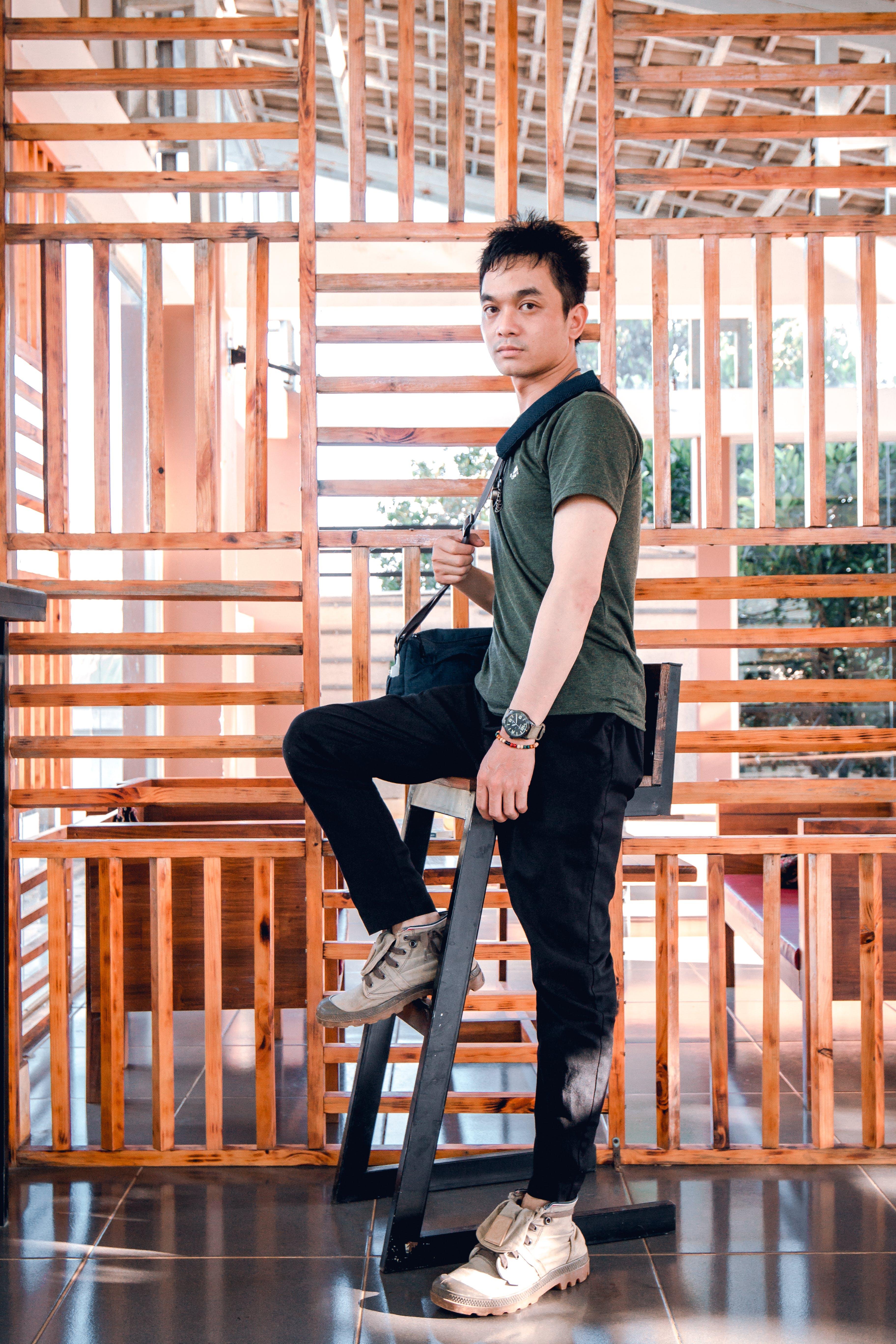 Man Standing Beside Chair