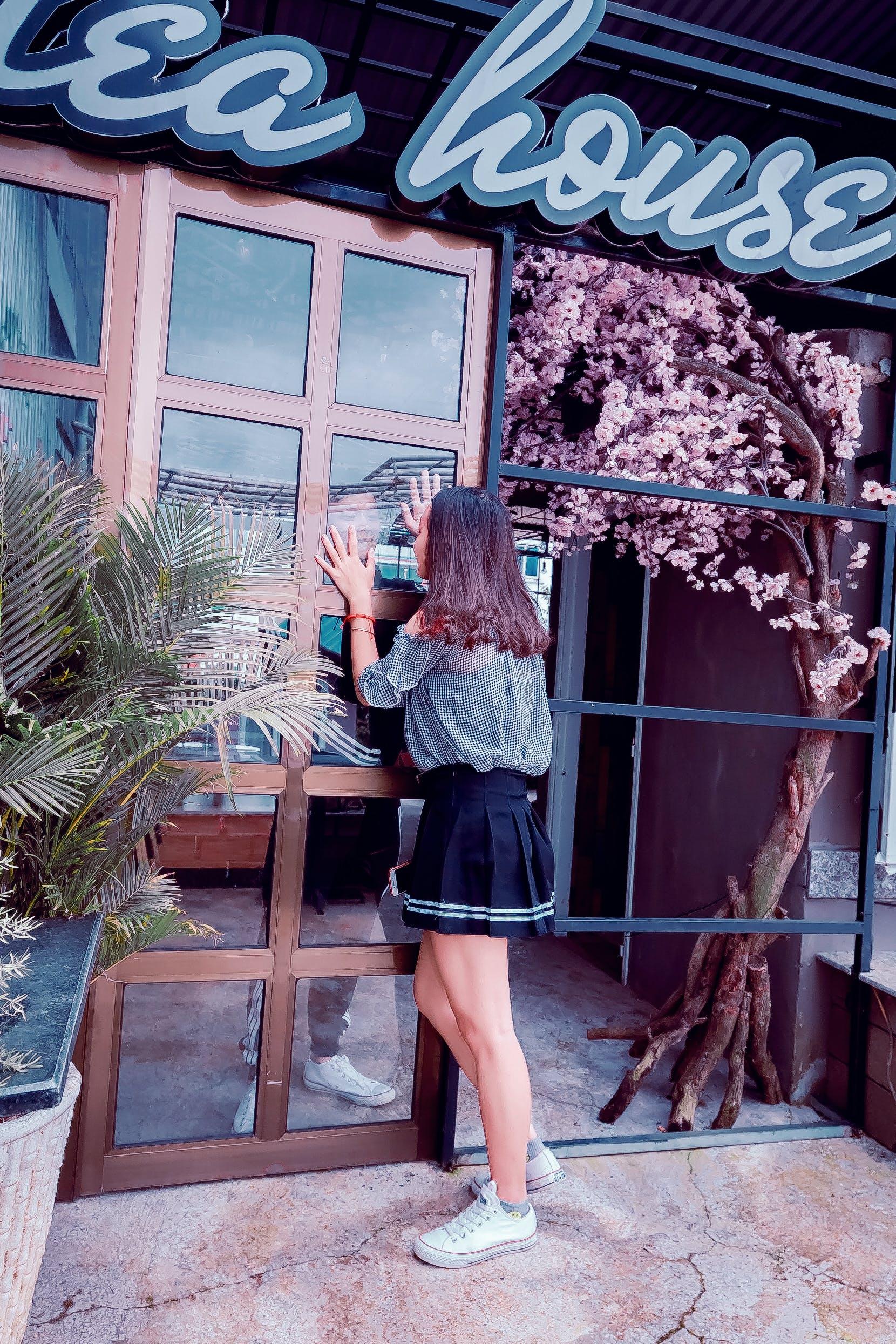 Woman Looking Through a Glass Door