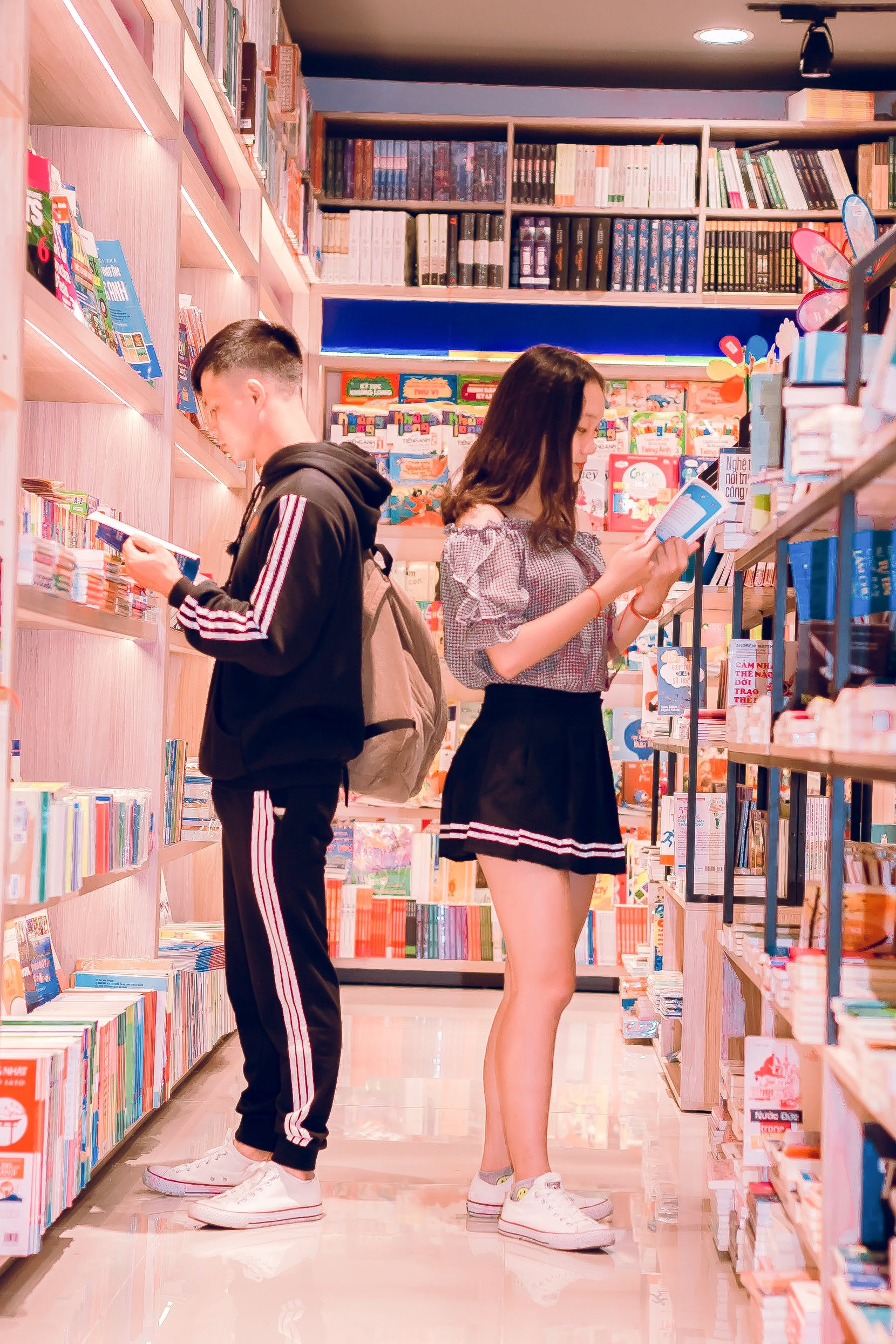 Man and Woman Reading Books