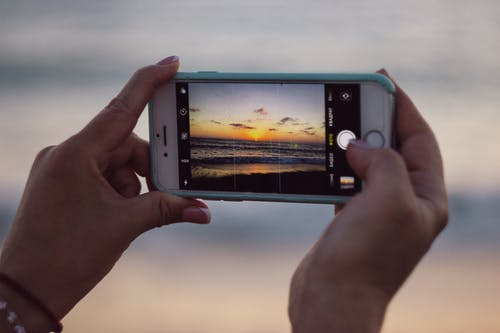 Free stock photo of cellphone, golden hour, phone, sea