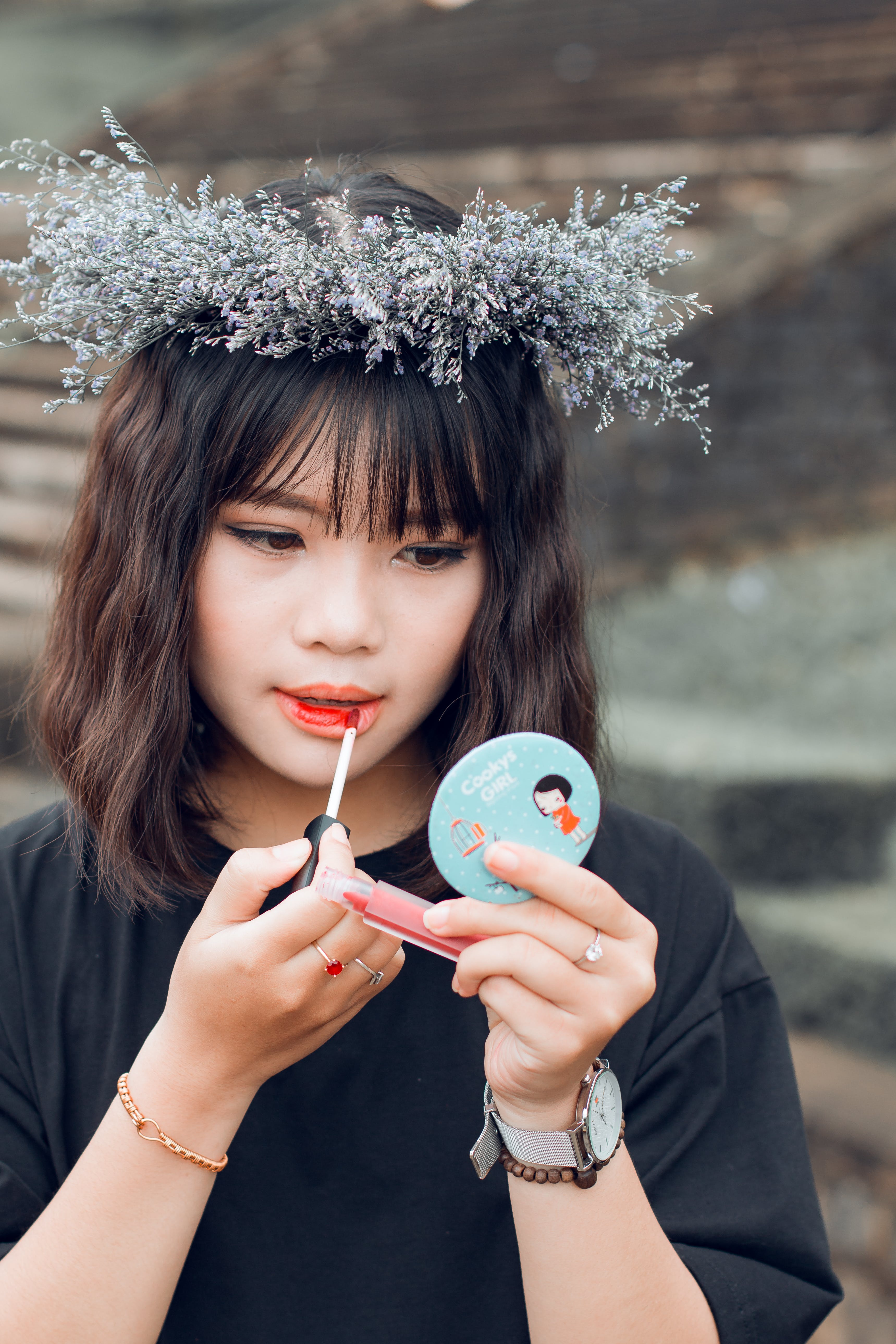 Woman Putting Lip Tint on Her Lips