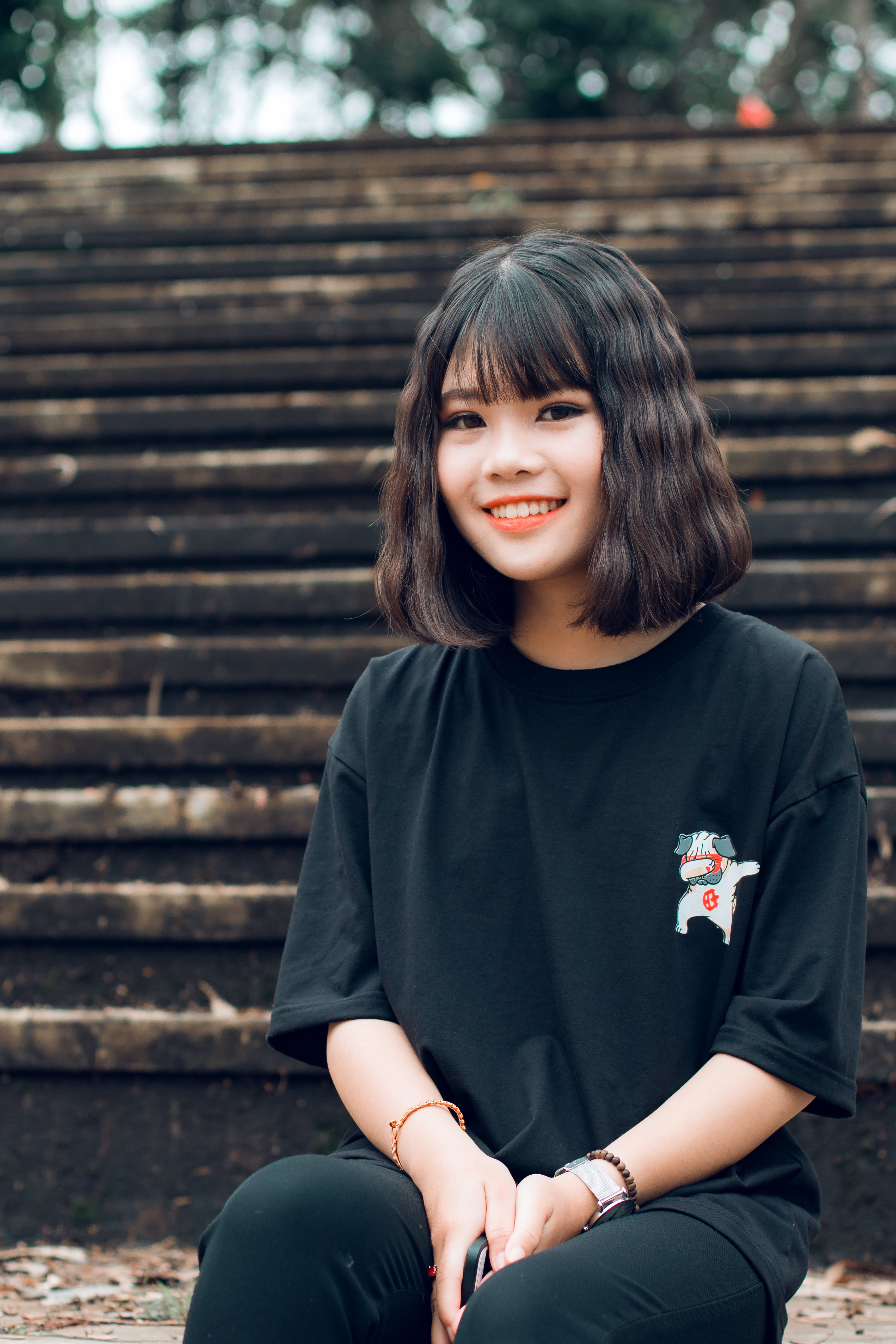 Woman Wearing Black Crew-neck T-shirt Sitting on Stair