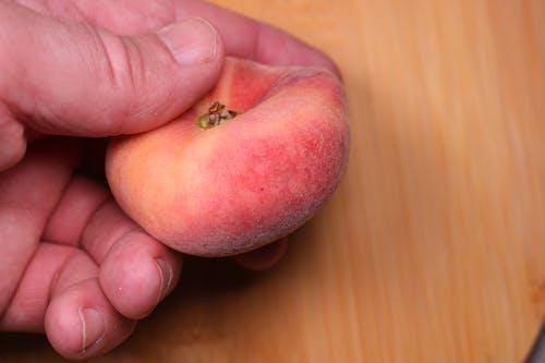 Free stock photo of chopping, chopping board, hand, peach