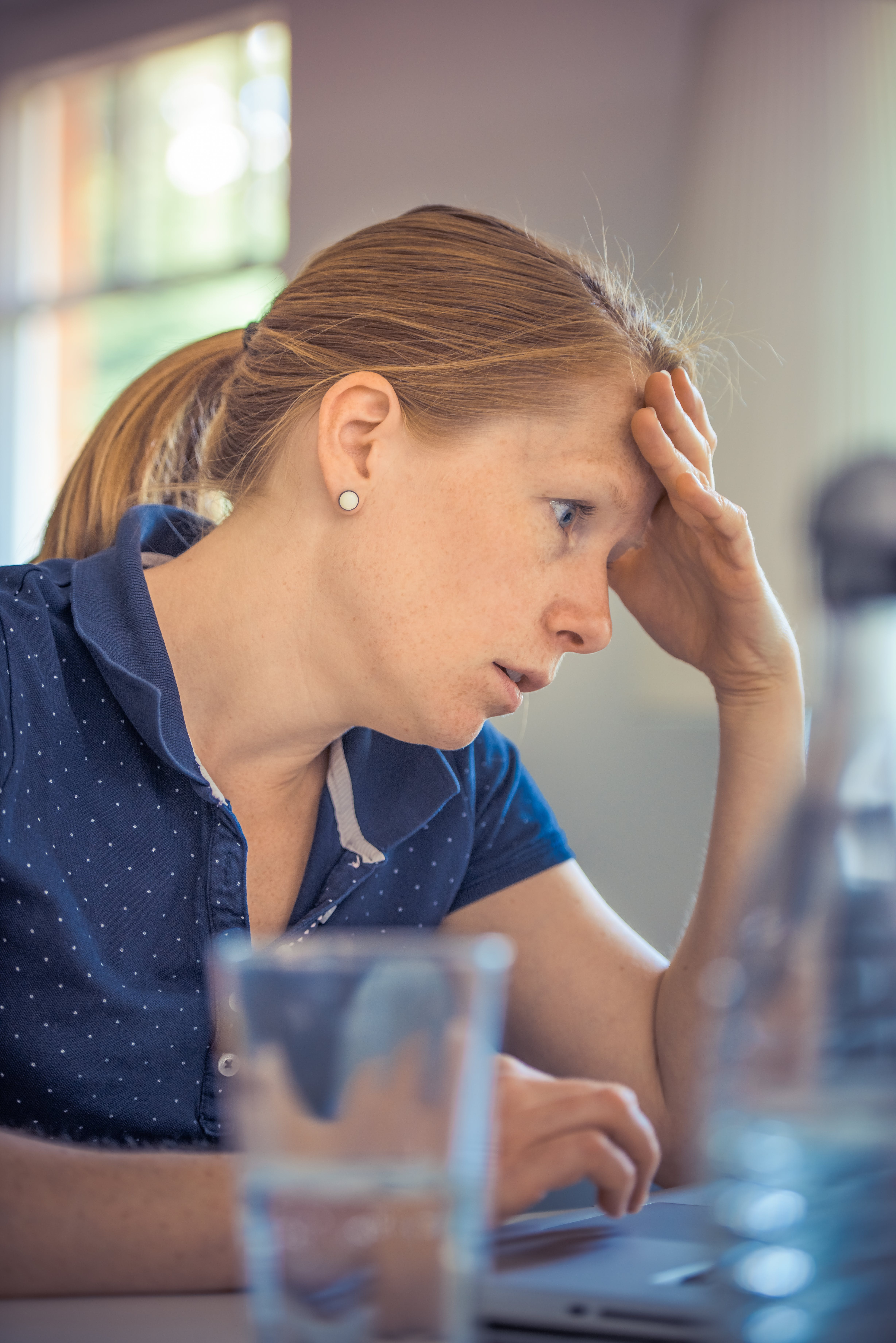 Woman Sitting in Front of the Laptop Computer in Shallow Photo