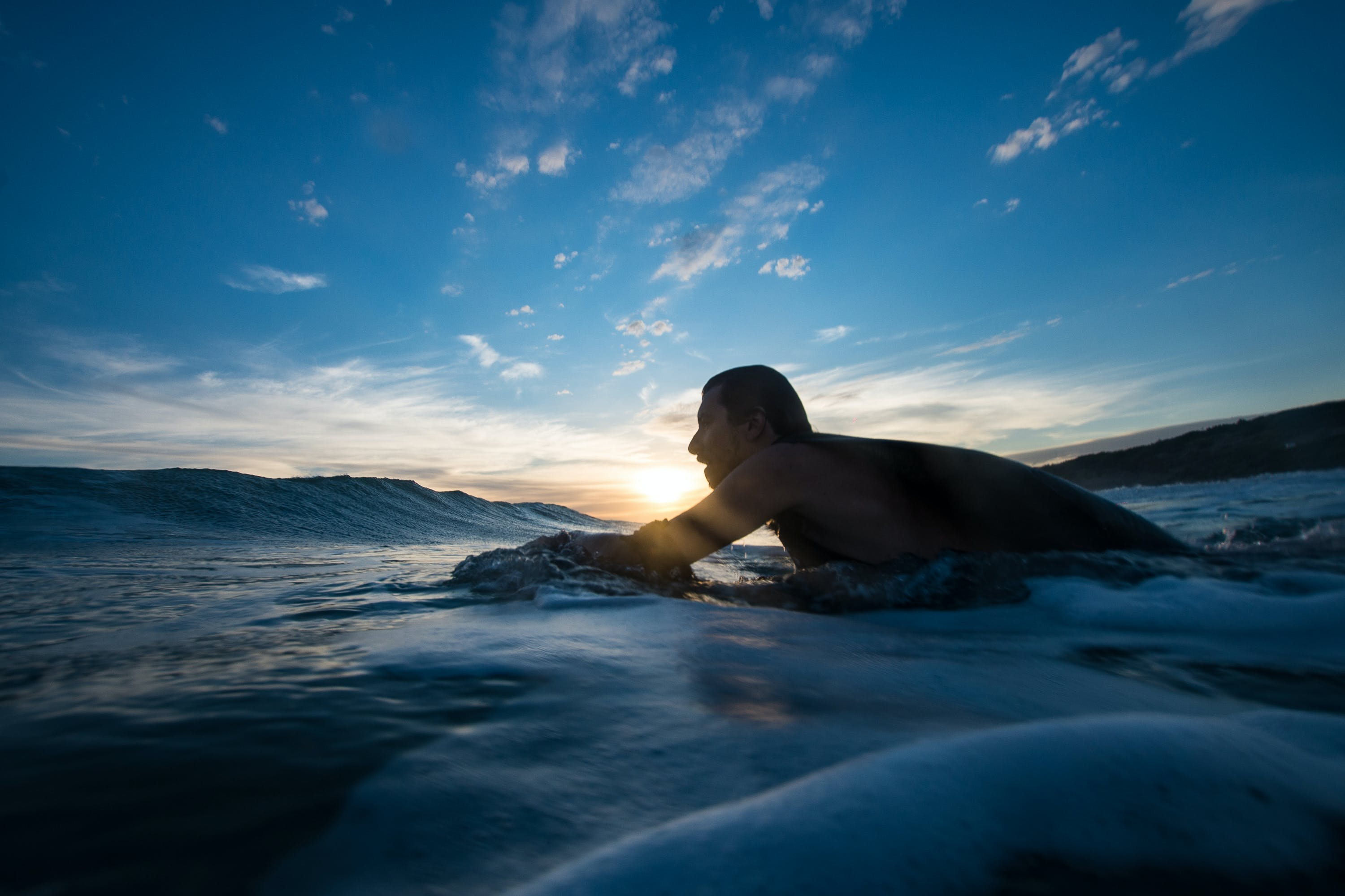 Man Surfing during Blue Hour