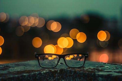 Bokeh Photography Of Black Framed Eyeglasses