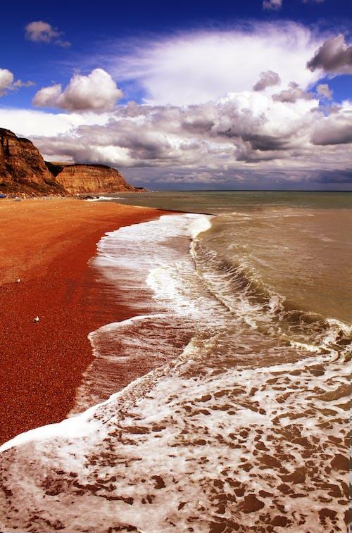 Photos gratuites de bord de mer, cailloux, ciel, côte