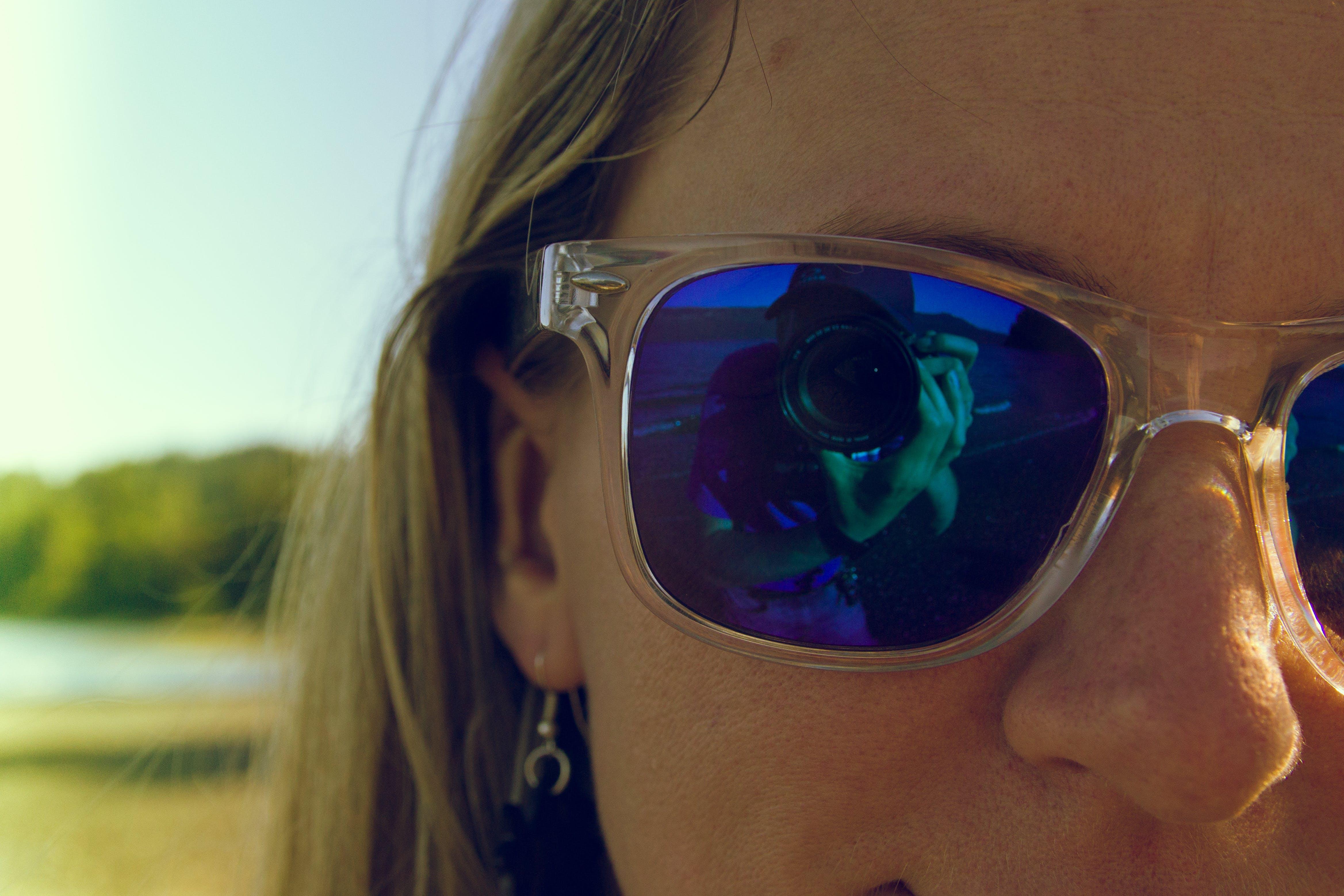 Woman Wearing Blue Sunglasses