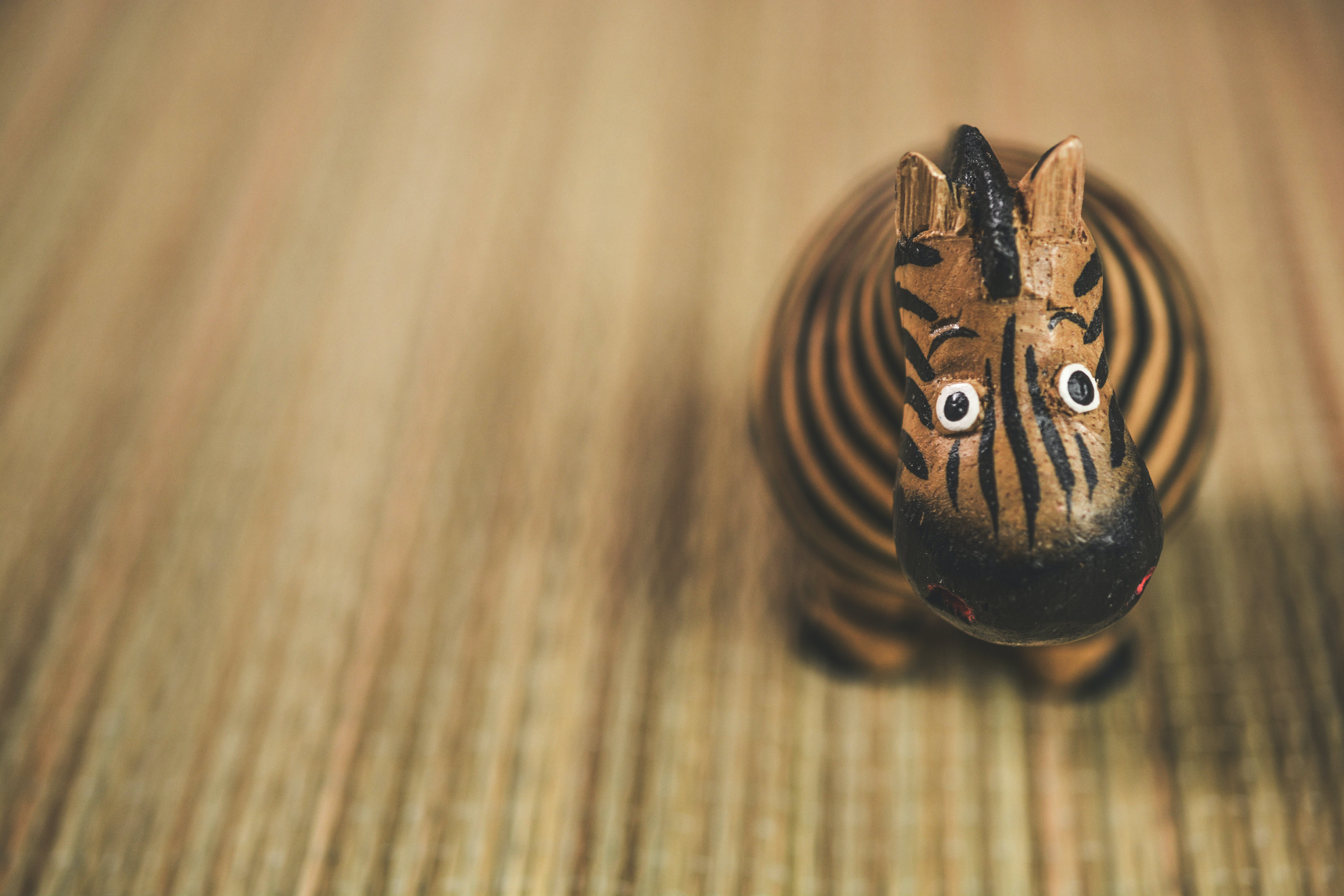 Close Photography of Beige and Black Zebra Toy