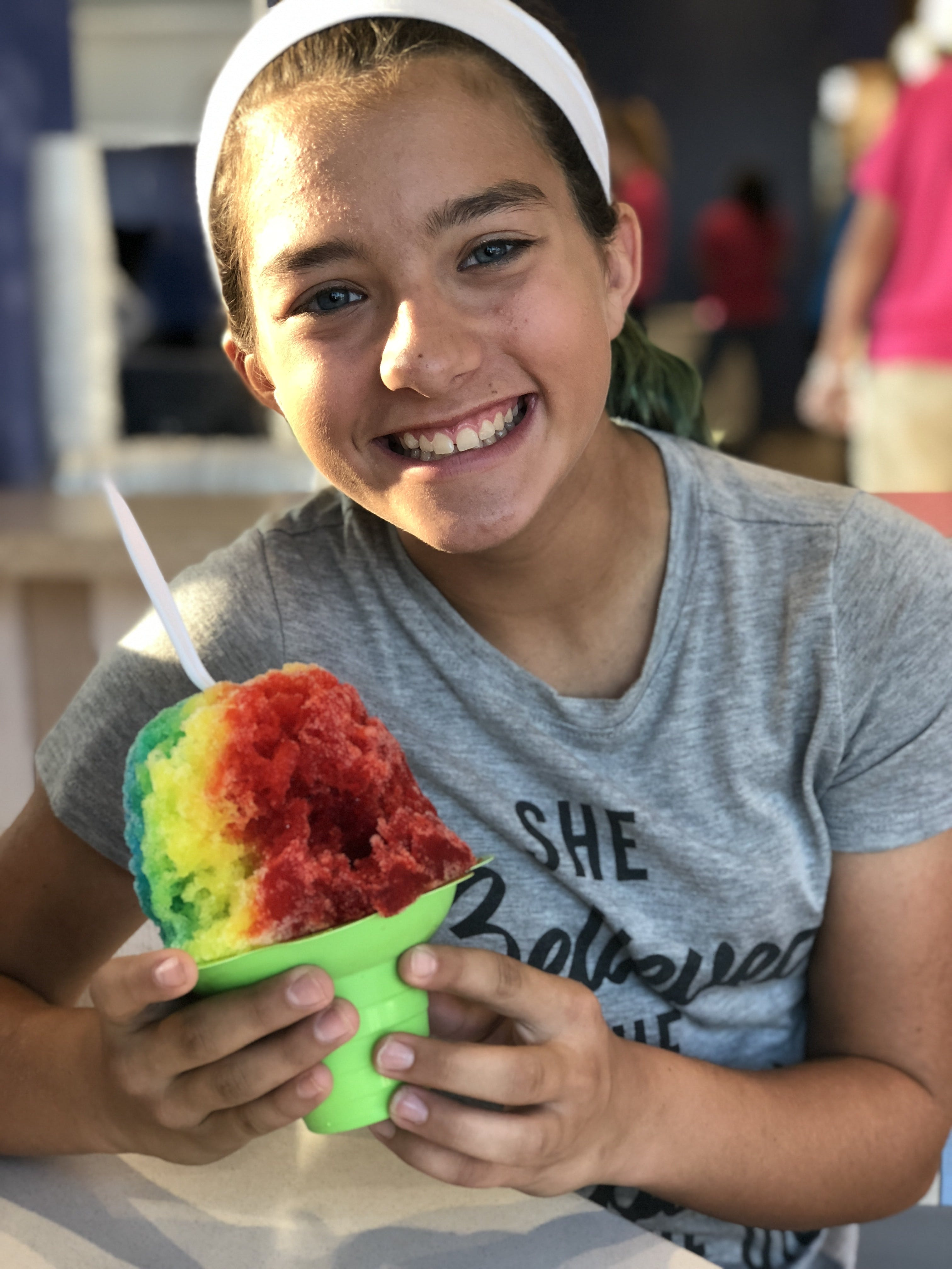 Girl Sitting on Chair While Holding Ice Cream