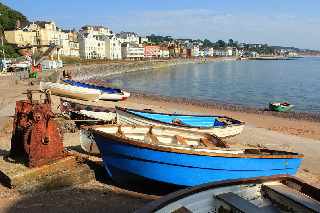 Row of Blue and White Dinghy Boats
