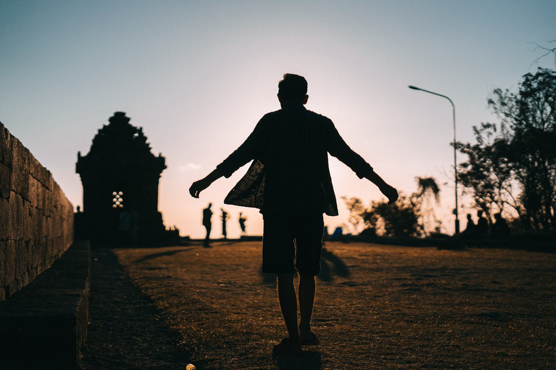 Silhouette of a Person During Dawn